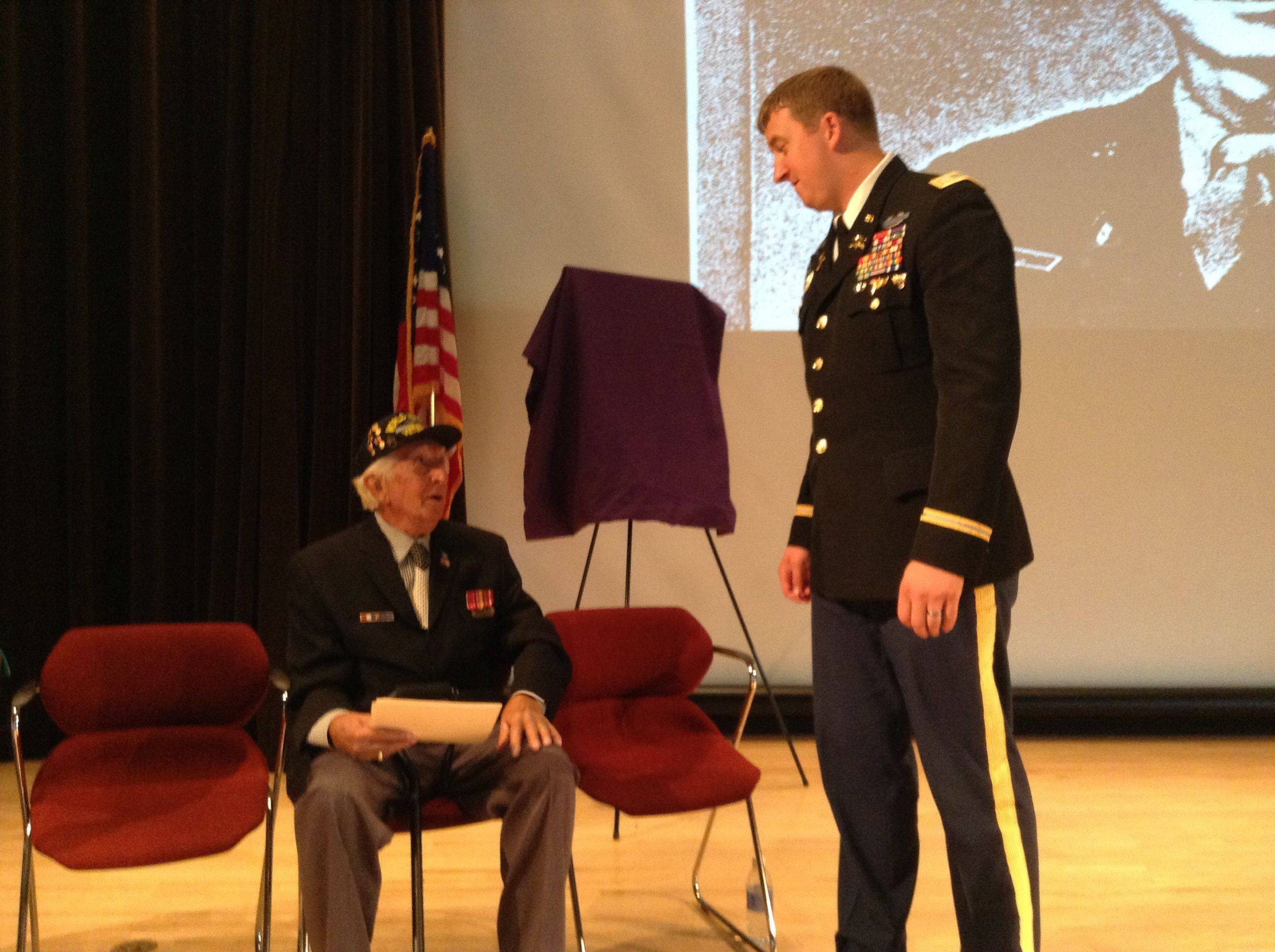 Former Army Staff Sgt. John Trinca of Antioch Township talks with Army Capt. Zachariah Fike at the College of Lake County on Sunday. Fike was instrumental in bringing together Trinca and the family of Thomas Bateman, a soldier whose death Trinca witnessed during World War II.