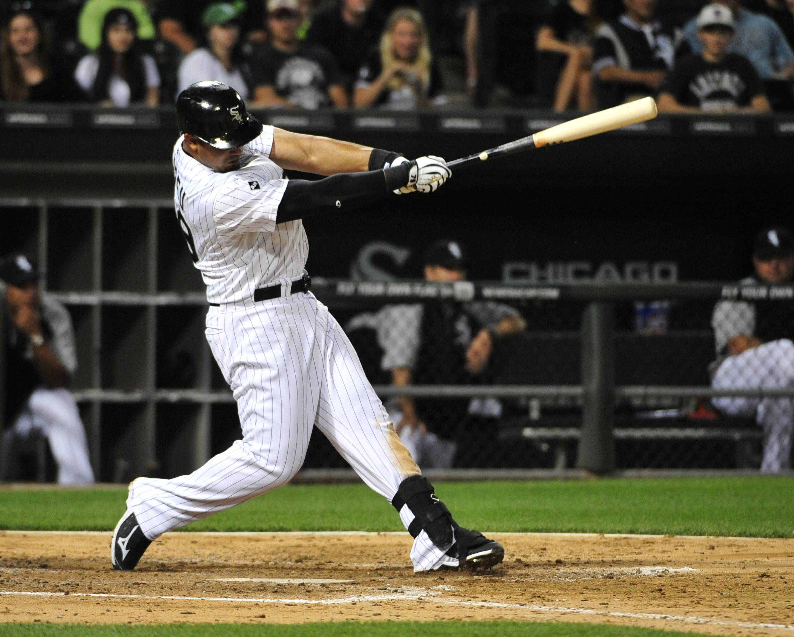 Jose Abreu hits an RBI single against the Minnesota Twins during the fourth inning Friday night. In July he hit .374.