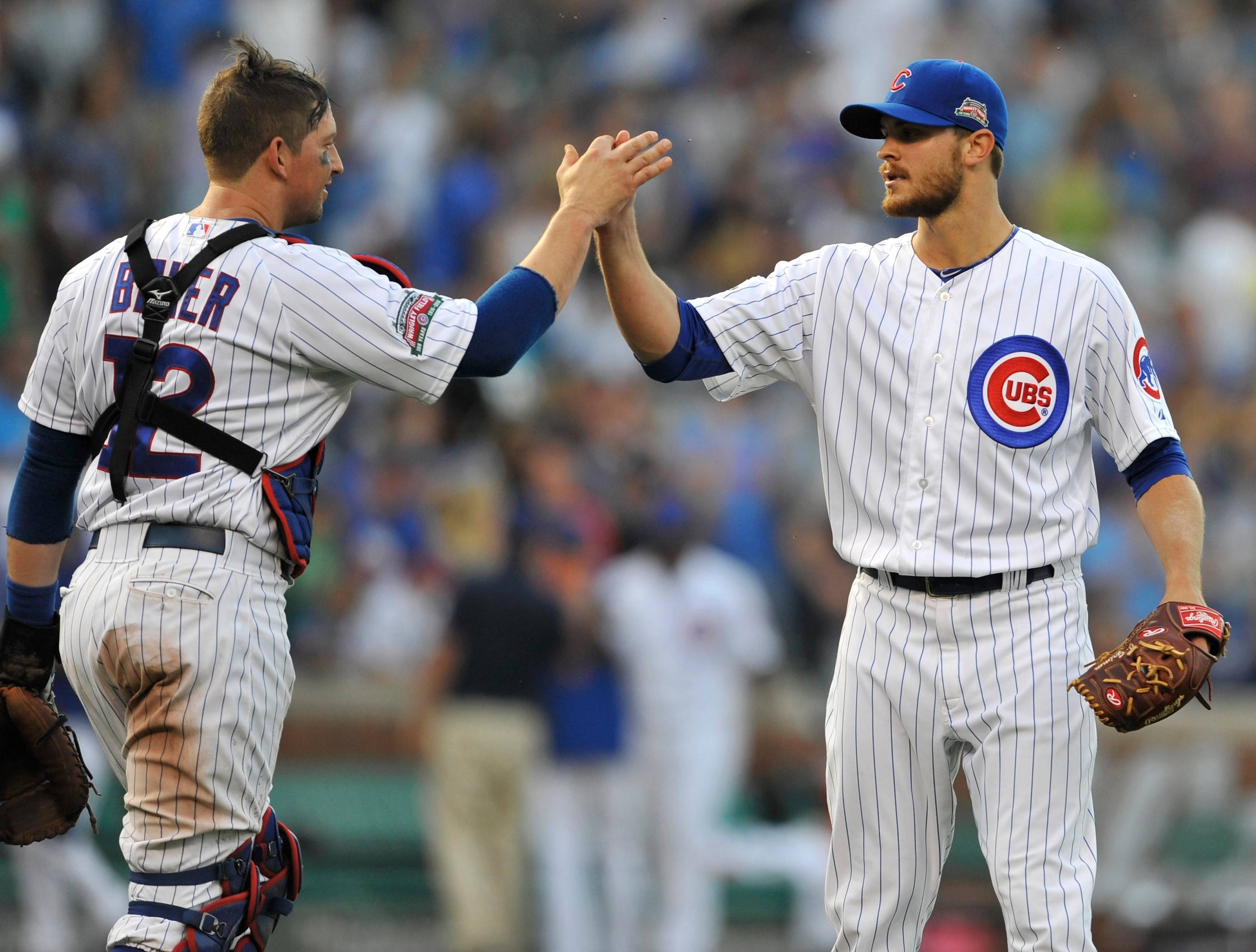 Like other members of the Cubs bullpen, Justin Grimm, right, has been called upon a lot by manager Rick Renteria.