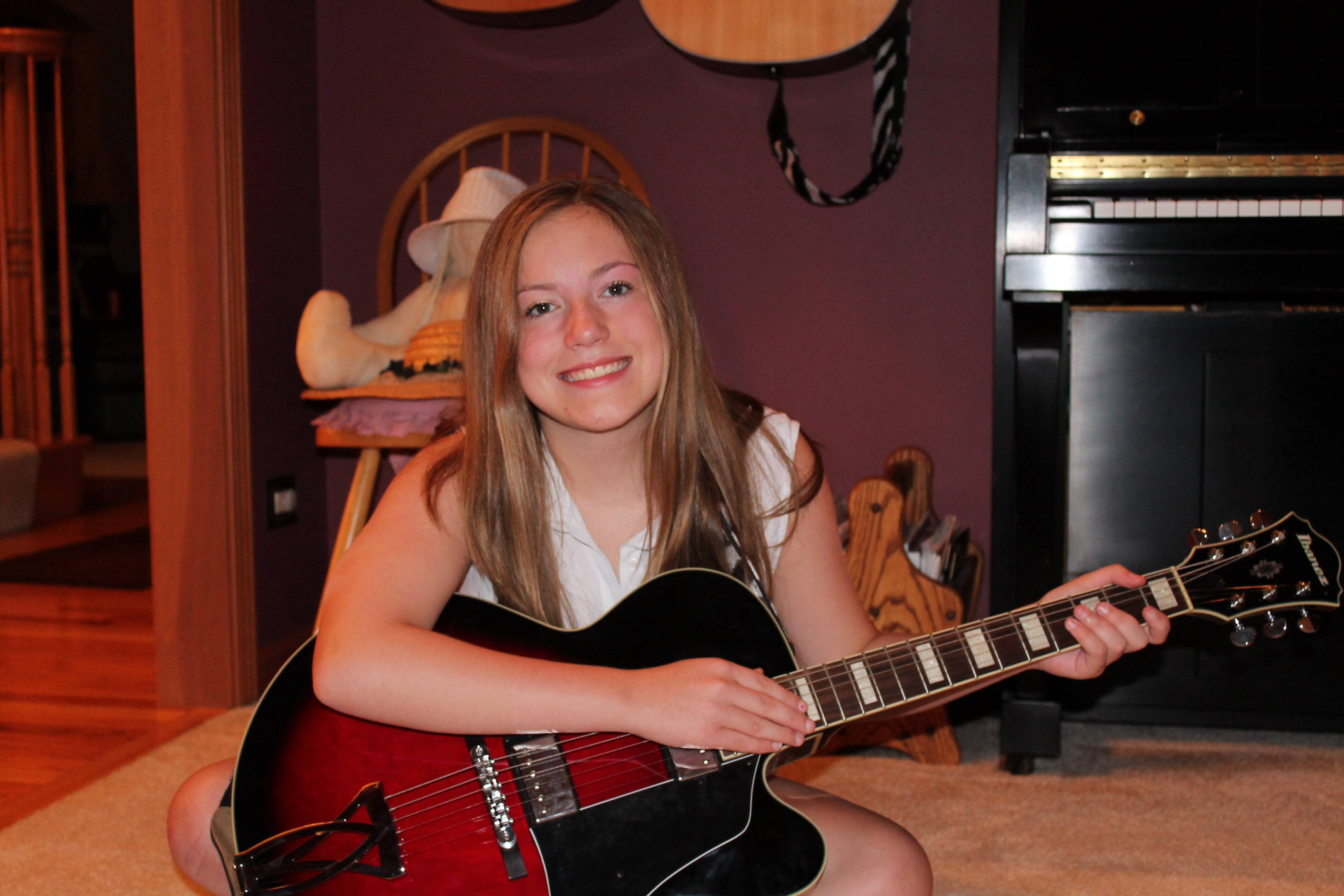 Twelve-year-old Bailey Cates, guitarist and pianist, will perform a concert to raise money for the Kaneland Arts Initiative.