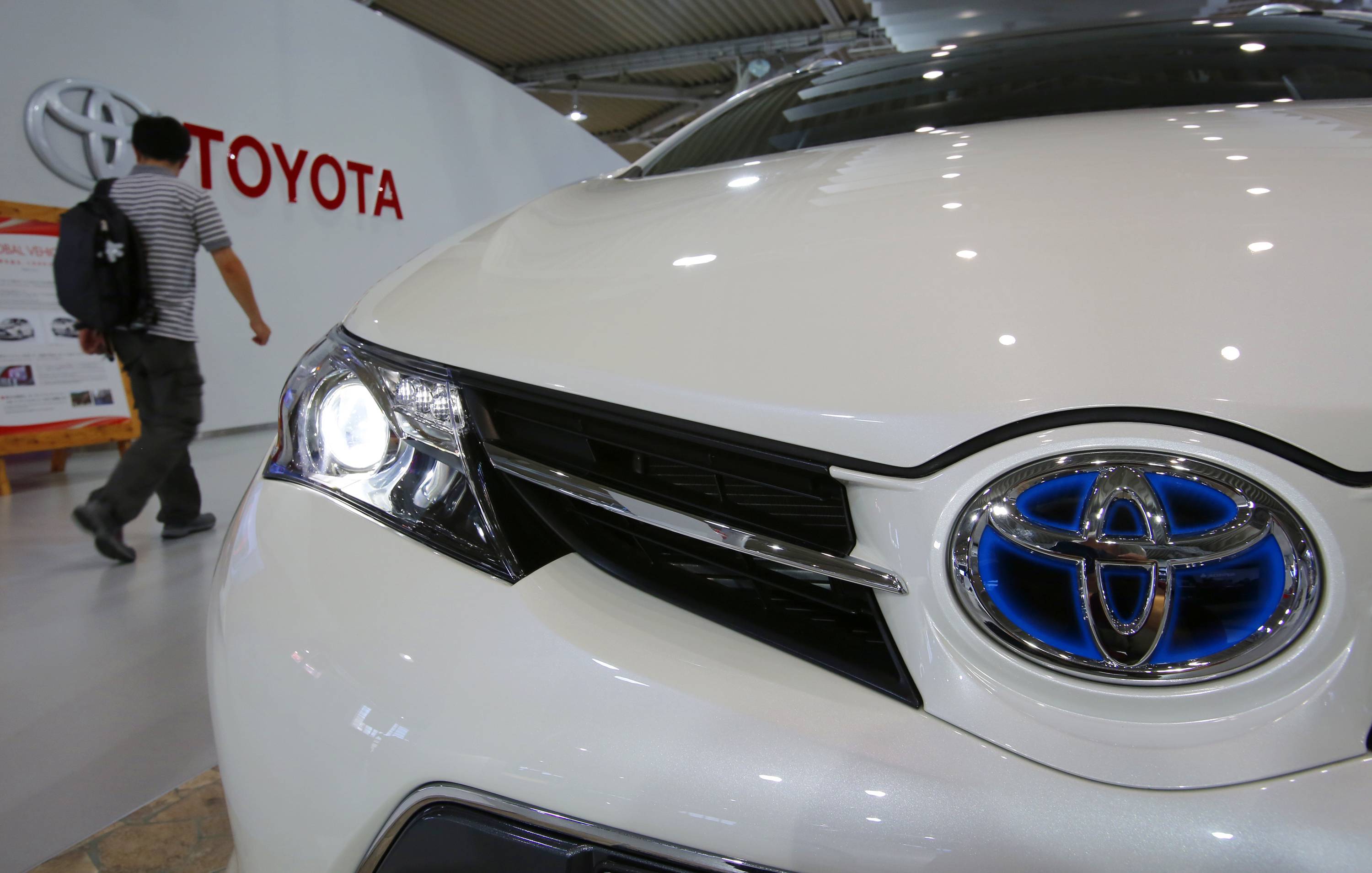 Toyota Motor Corp. reported a 5 percent jump in quarterly profit Tuesday, outpacing expectations as vehicle sales grew in North America and Europe, offsetting a drop in Japan.