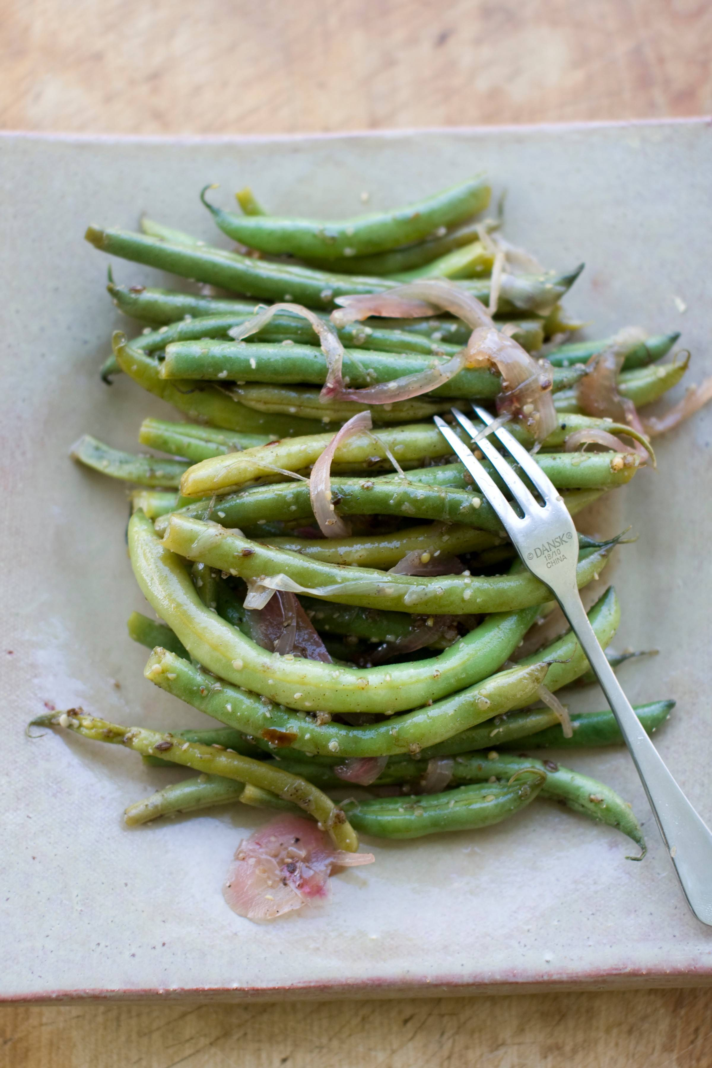 Once jarred and cooled, pickled green beans can be stored in the refrigerator for five days.