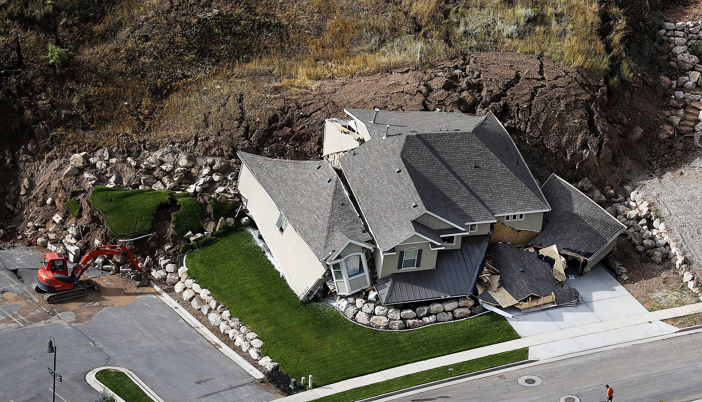 A home is destroyed Tuesday following a landslide in a hillside community of North Salt Lake, Utah.