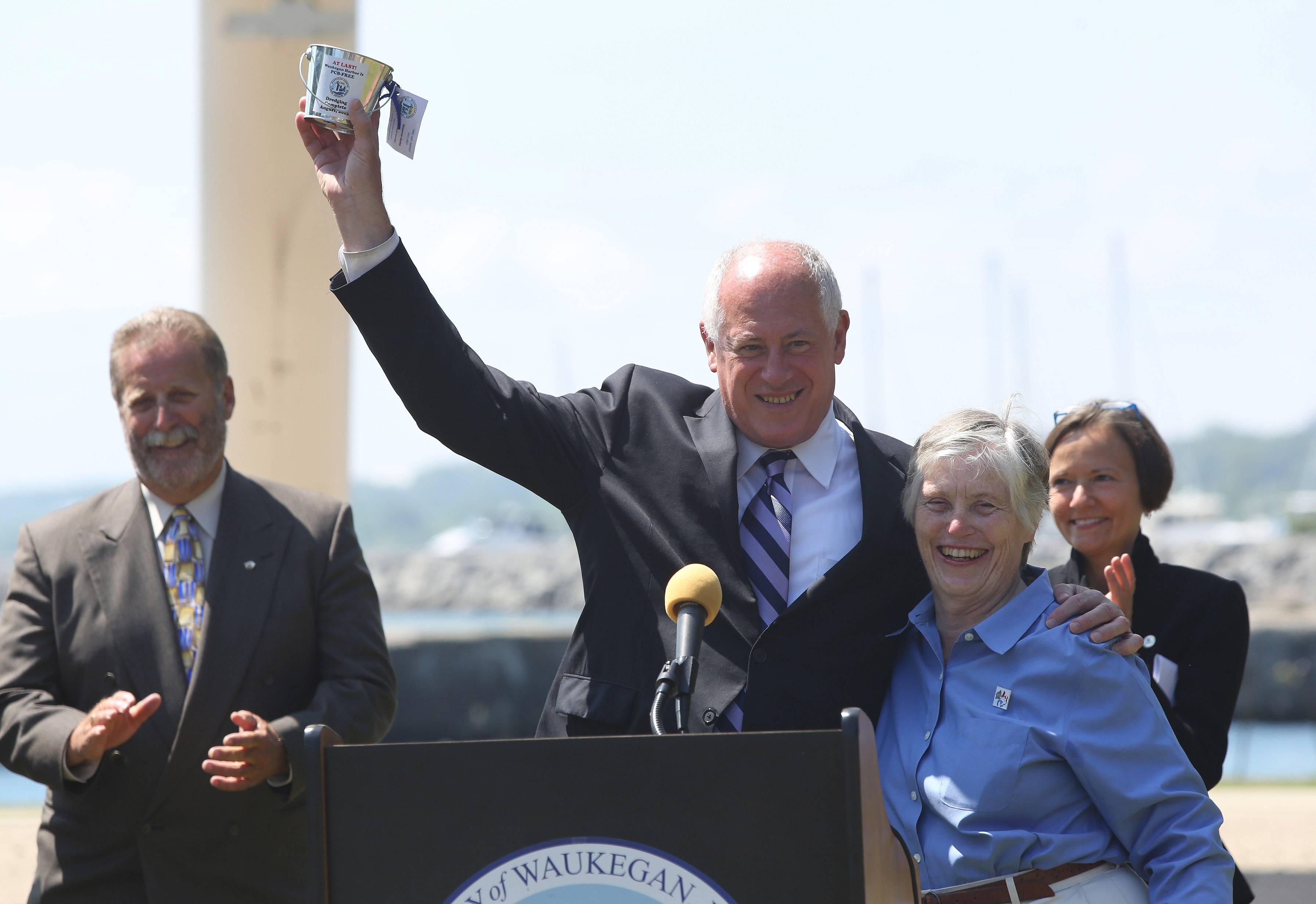 Gov. Pat Quinn holds up a bucket given to him by Susie Schreiber, chairwoman of the citizens advisory committee, during Tuesday's announcement of the completion of the Waukegan Harbor cleanup and its removal from the list of Great Lakes Areas of Concern. Speakers included U.S. Sen. Mark Kirk and Dick Durbin, U.S. Rep. Brad Schneider and Waukegan Mayor Wayne Motley.