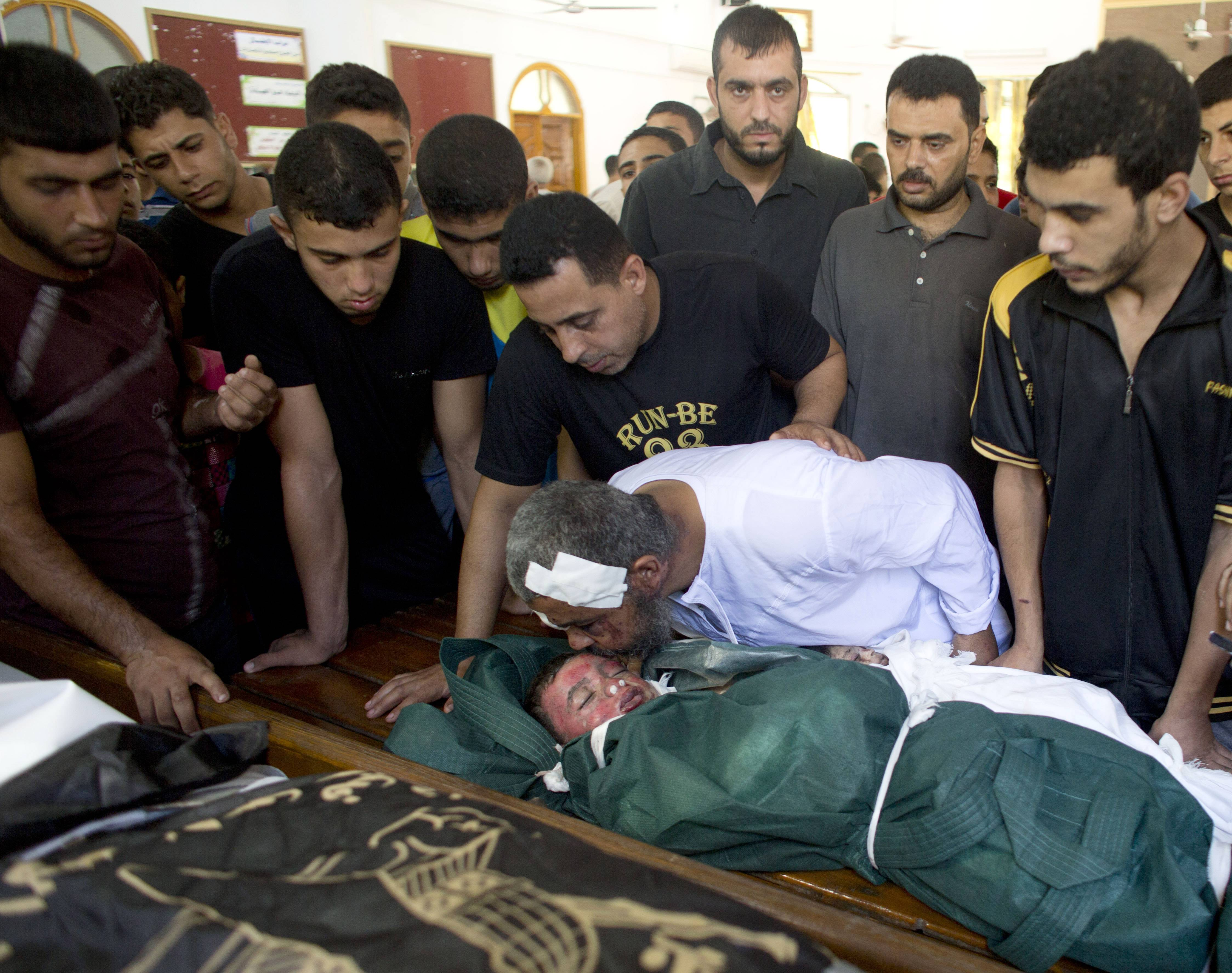Al-Bakin family members mourn Monday for three year-old Kamal and two other family members during their funeral in Gaza City. The boy was killed along with two other family members in an Israeli missile strike on their home in the Shati refugee camp, Gaza City, on Monday.