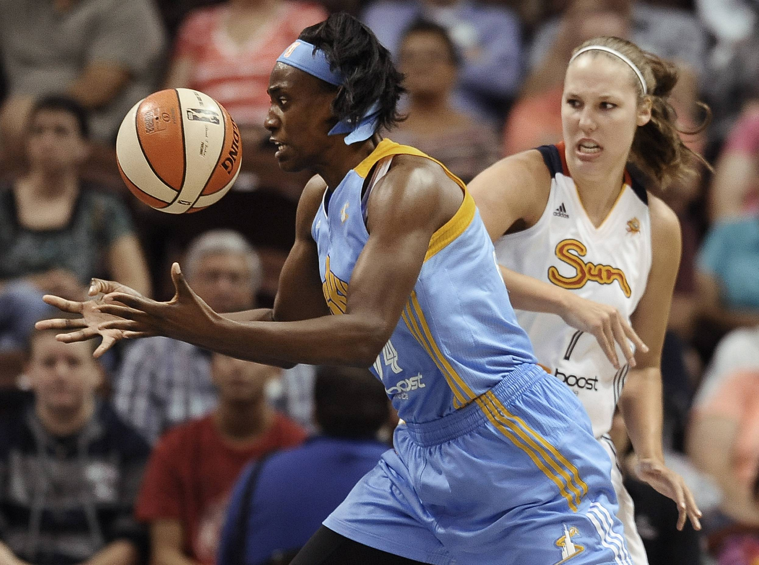 Chicago Sky's Sylvia Fowles, left, reaches for the ball as Connecticut Sun's Kayla Pedersen, right, defends during the first half of a WNBA basketball game, Tuesday, Aug. 5, 2014, in Uncasville, Conn. (AP Photo/Jessica Hill)