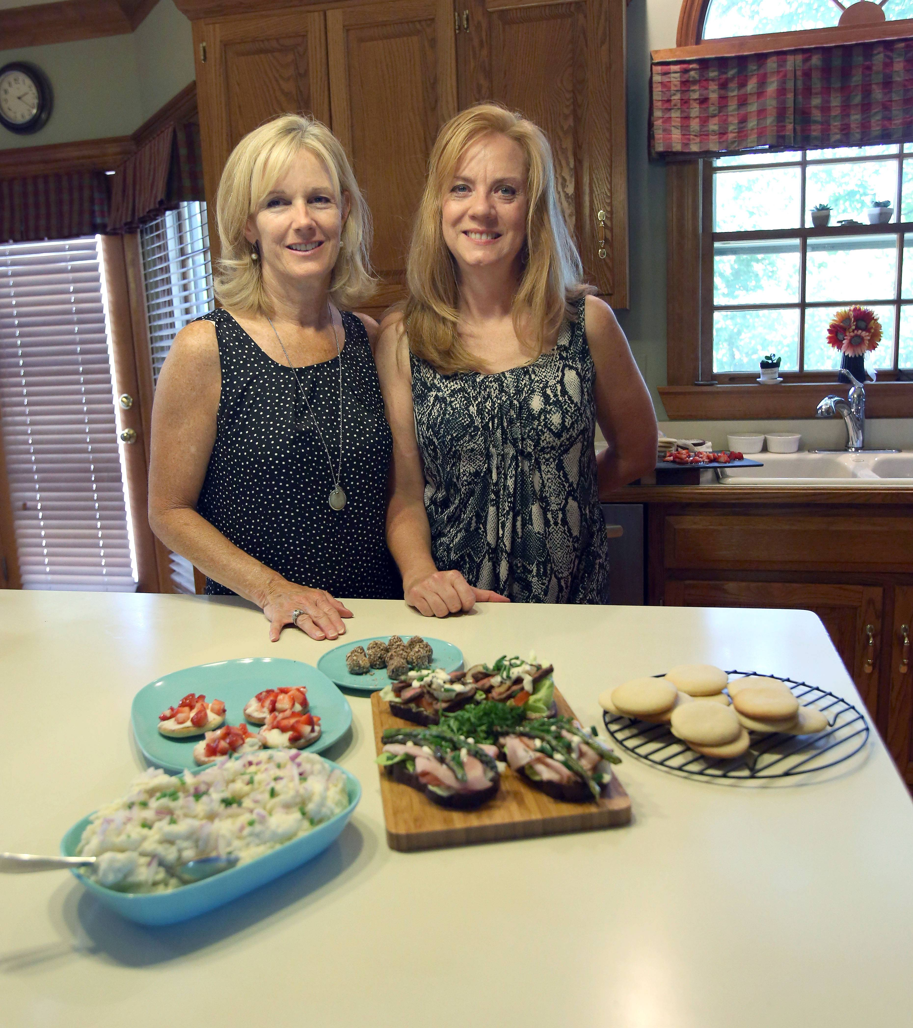 Beth Fawcett of Wheaton, left, and Annette Barum-Sindberg of Chicago, show off their Danish smushi open-faced sandwiches, Strawberry Medallion Cookies and Eva's Mashed Potato Salad that will be part of their cookbook.