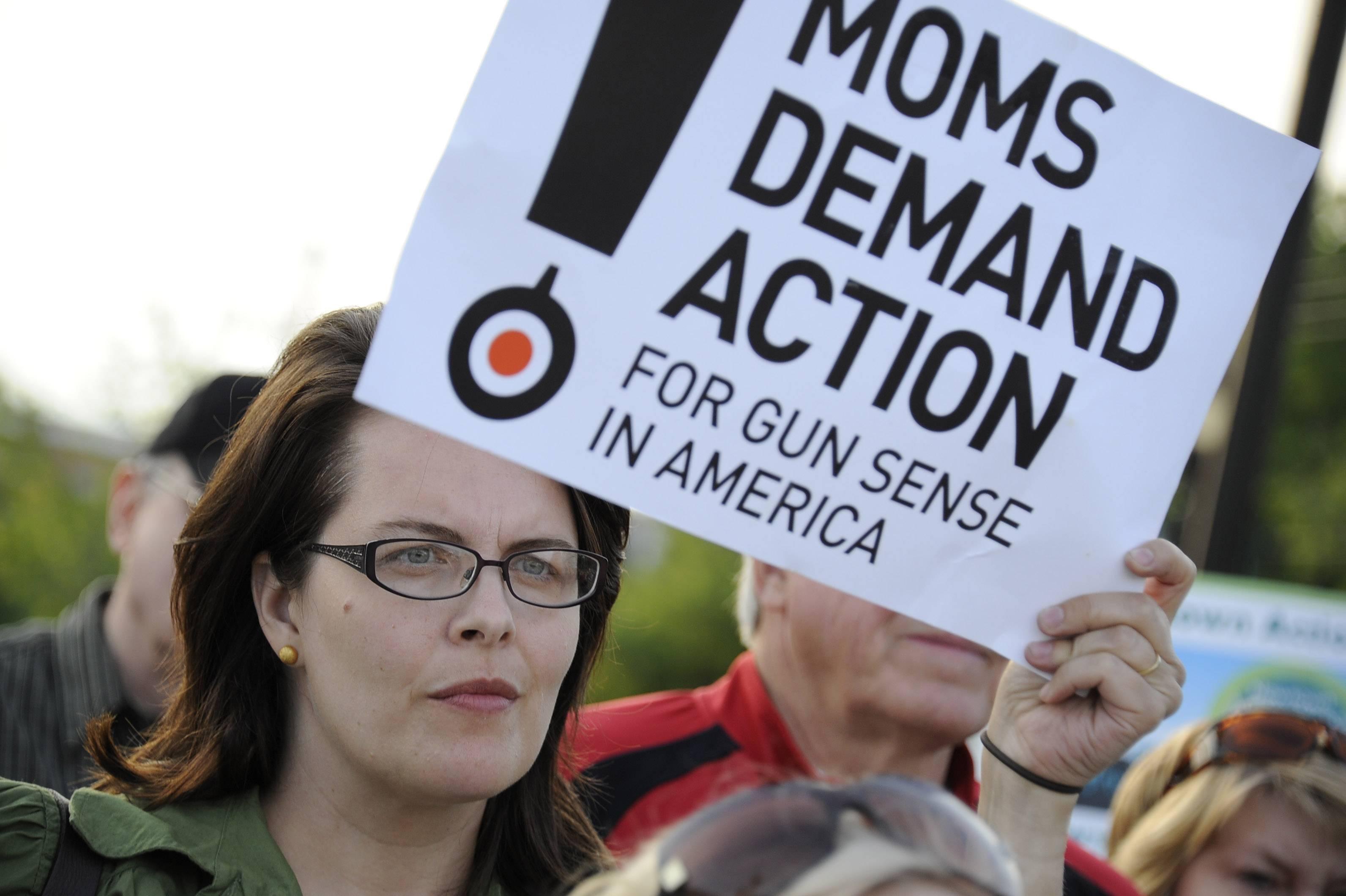 Christine Fenno, of Oak Park, protests gun violence at a June 2013 vigil in Palatine, marking the six-month anniversary of the Sandy Hook shootings.