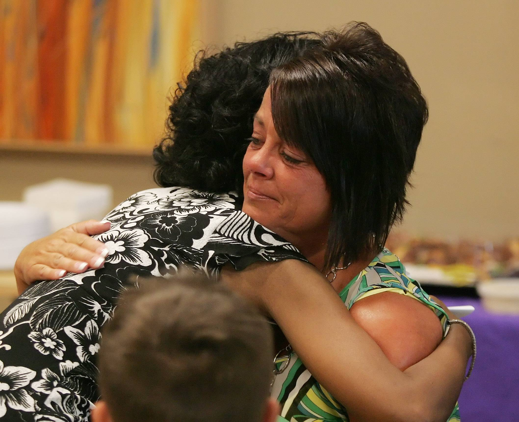 Heart transplant patient Melody McIntosh, left, hugs Kelly Swart, mother of Ashley Swart, during a meeting at Advocate Condell Medical Center in Libertyville on Monday. Ashley Swart, a 20-year-old Purdue student, died of a brain aneurysm in 2013, and her donated heart saved McIntosh's life.