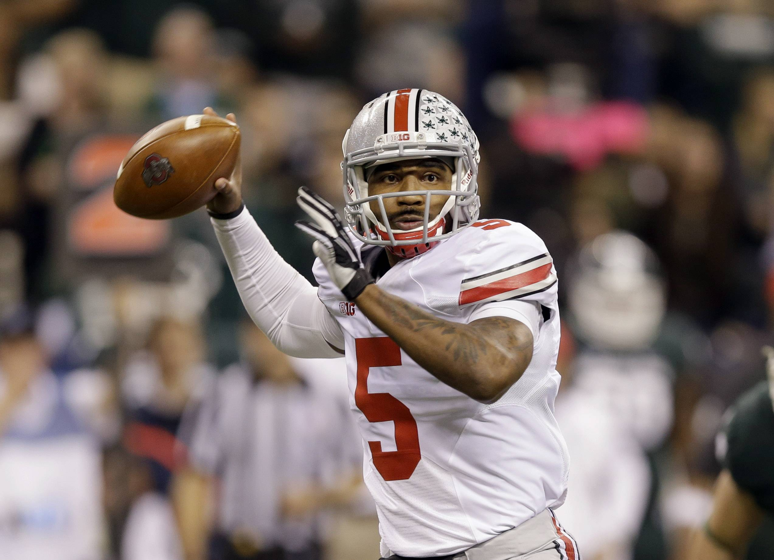 Associated Press/Dec. 7, 2013Ohio State quarterback Braxton Miller was the Big Ten MVP last season, throwing for 2,094 yards and 24 touchdowns and rushing for 1,068 yards and 12 TDs.