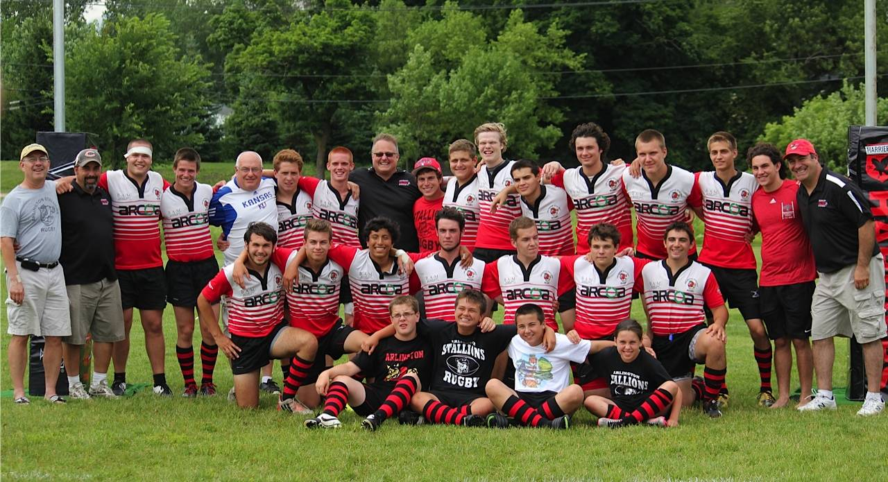 Players and coaches of the Arlington Stallions Rugby Club celebrate their iYRA 7's Rugby State Championship Tournament win in Lake Forest on July 12.