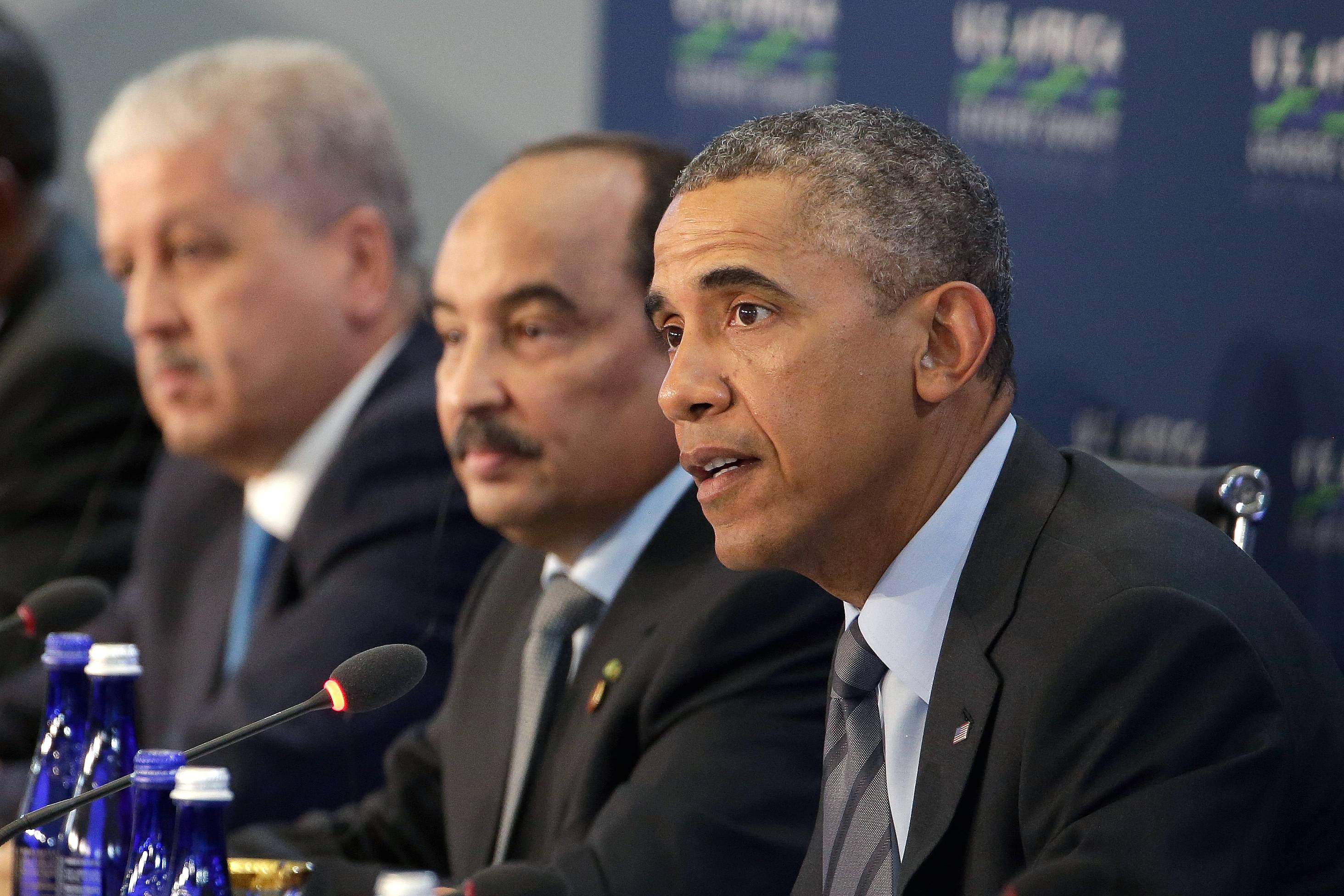 President Barack Obama, joined by Prime Minister of Algeria Abdelmalek Sellal, left, and President of Mauritania Mohamed Ould Abdel Aziz, center, speaks Wednesday during the opening session at the U.S. Africa Leaders Summit in Washington.