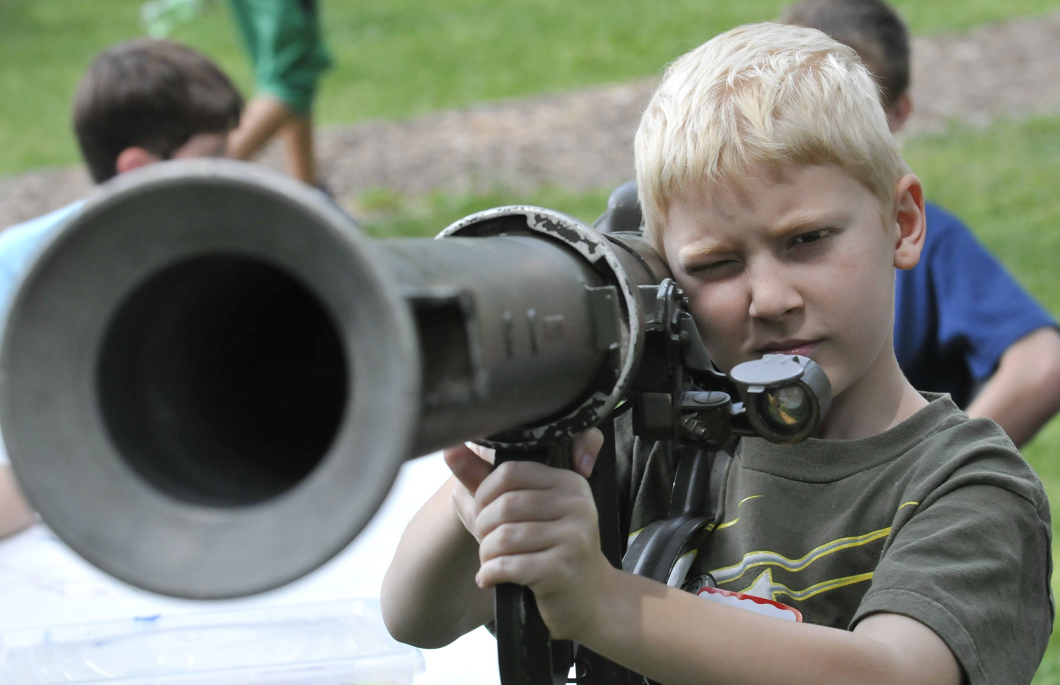 Caleb Watson of Wheaton shoulders a rocket launcher Wednesday as students ages 11 to 14 learned about military rockets and how they were used in the nation's wars during a summer program at the First Division Museum at Cantigny Park in Wheaton.