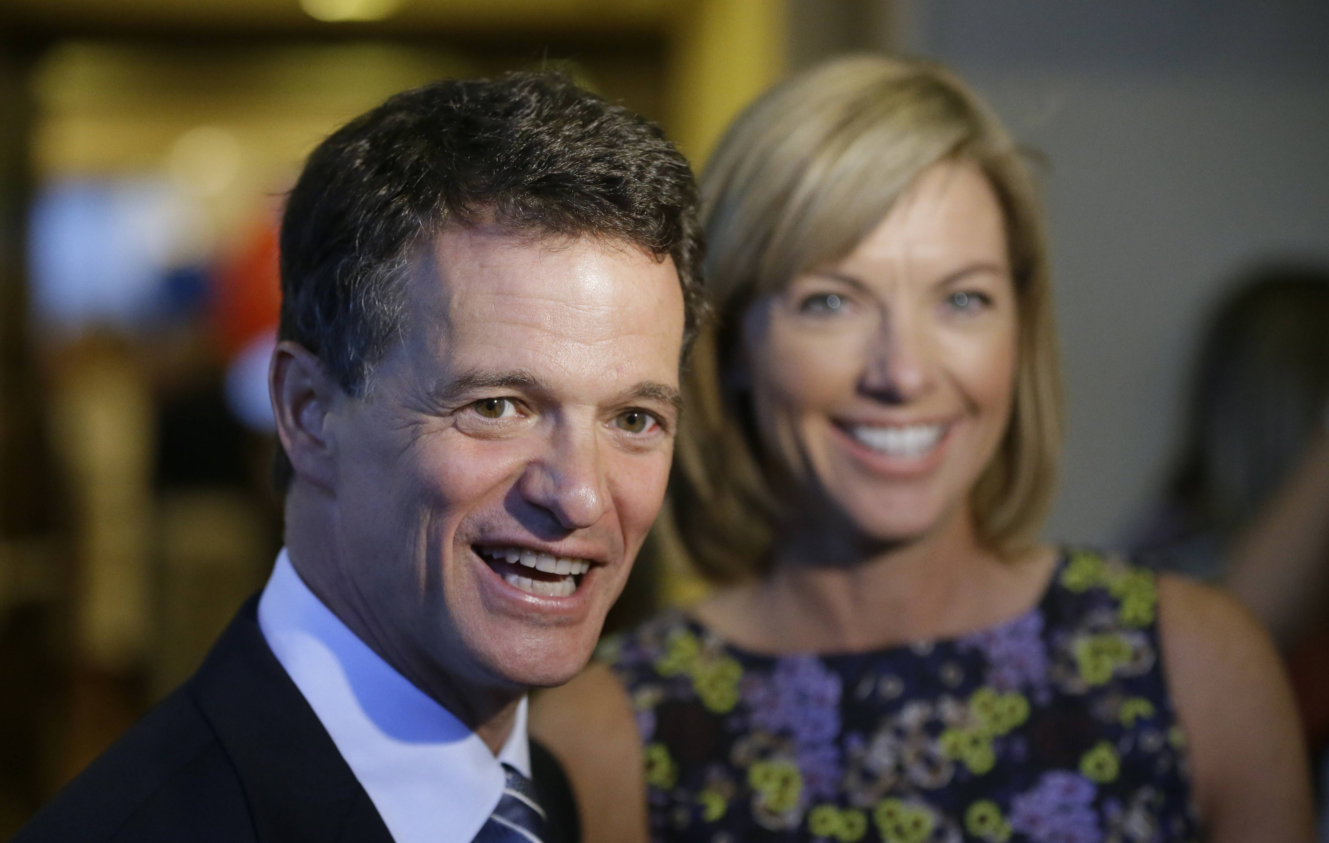 Republican David Trott, a candidate for Michigan's 11th congressional district, stands next to his wife, Kappy, Tuesday during an interview at his election night party in Troy, Mich. Trott defeated incumbent Rep. Kerry Bentivolio.