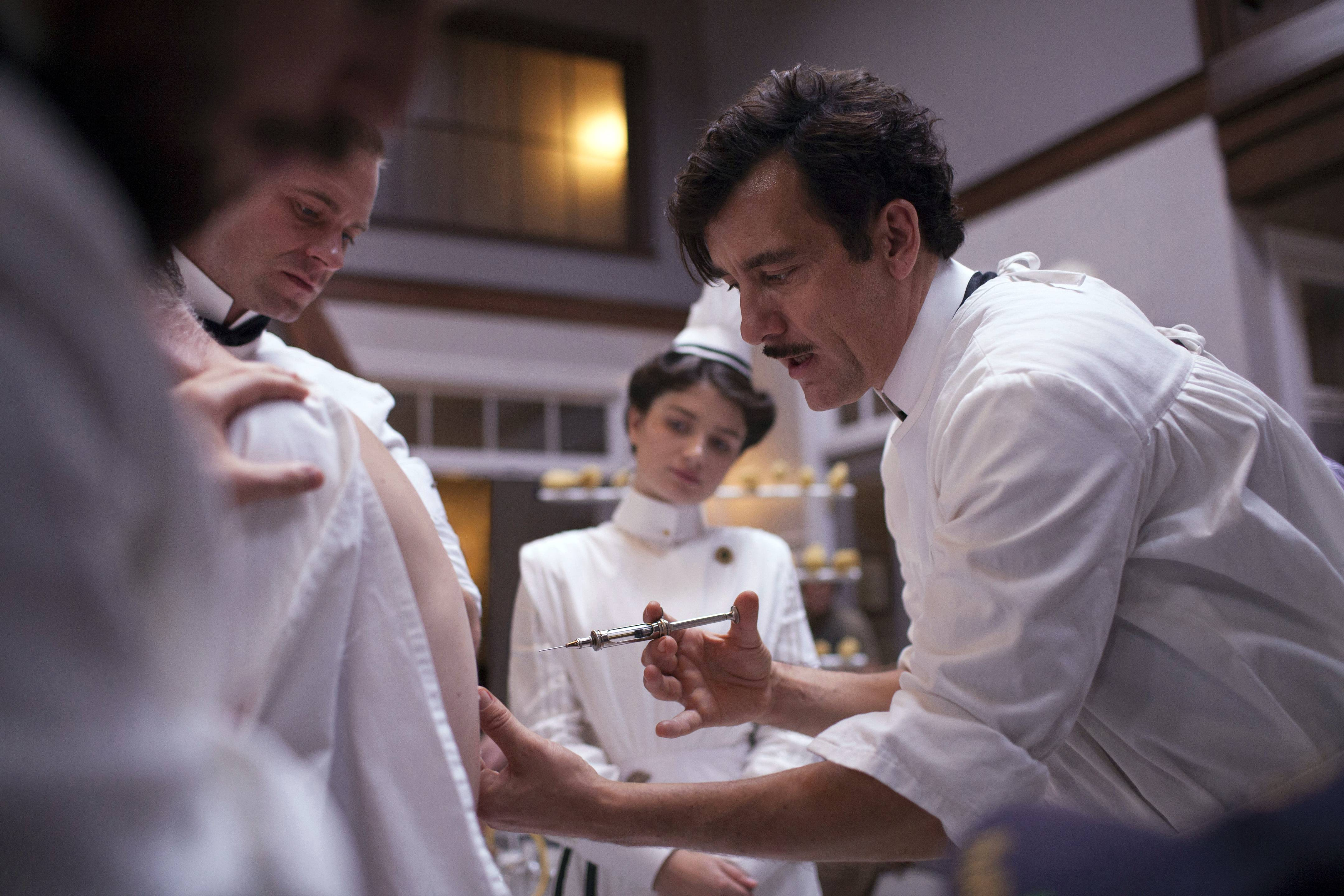 "Clive Owen, right, in a scene from ""The Knick,"" a 10-episode hospital drama premiering at 9 p.m. Friday on Cinemax."