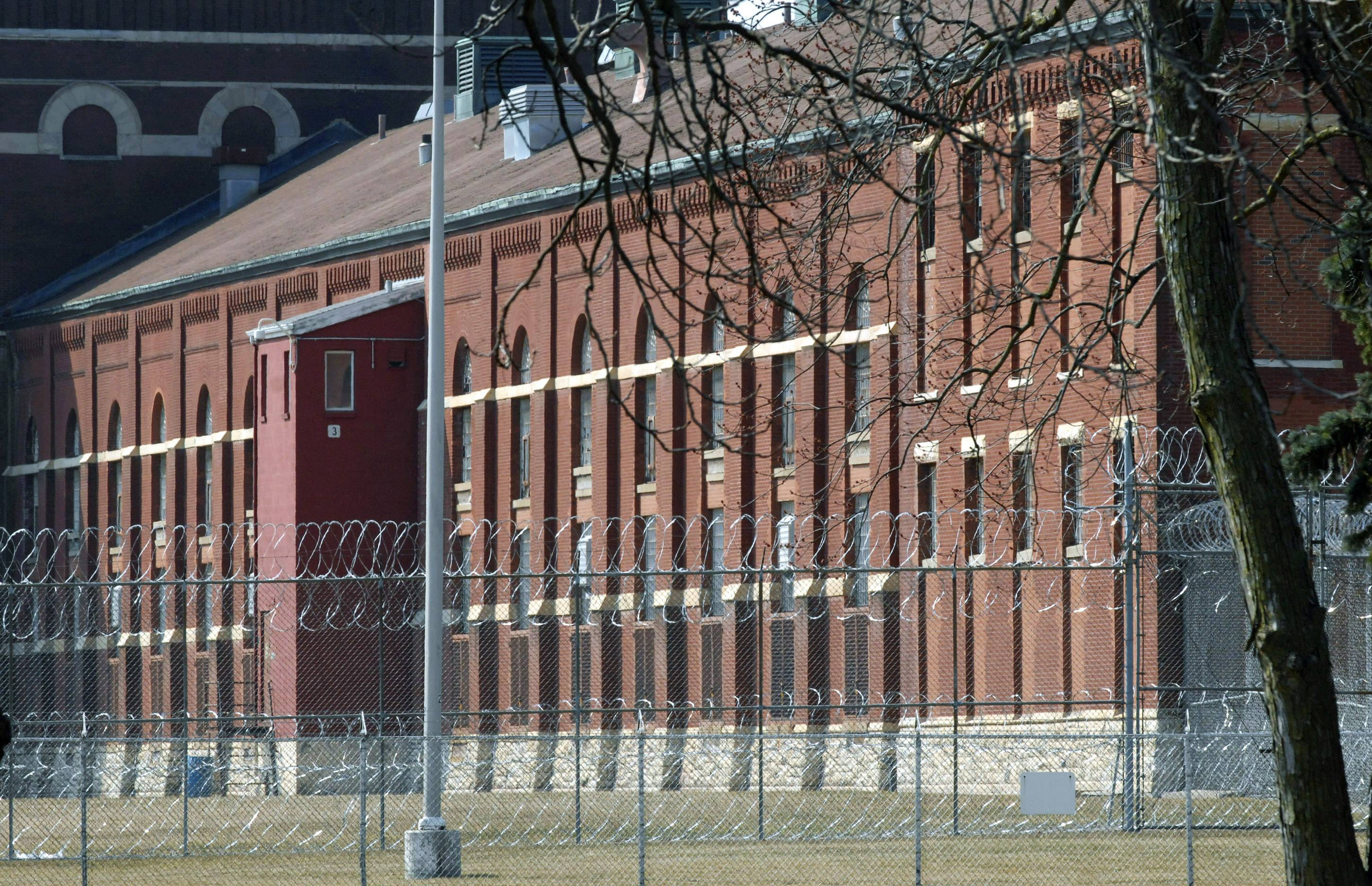 In this 2013 file photo, concertina wire surrounds the buildings of the Pontiac Correctional Center in Pontiac, Ill. Treating and housing mentally ill prisoners is costing more in Illinois. State documents show Illinois taxpayers will be billed more than $17.8 million to turn existing prison space into mental health care facilities.
