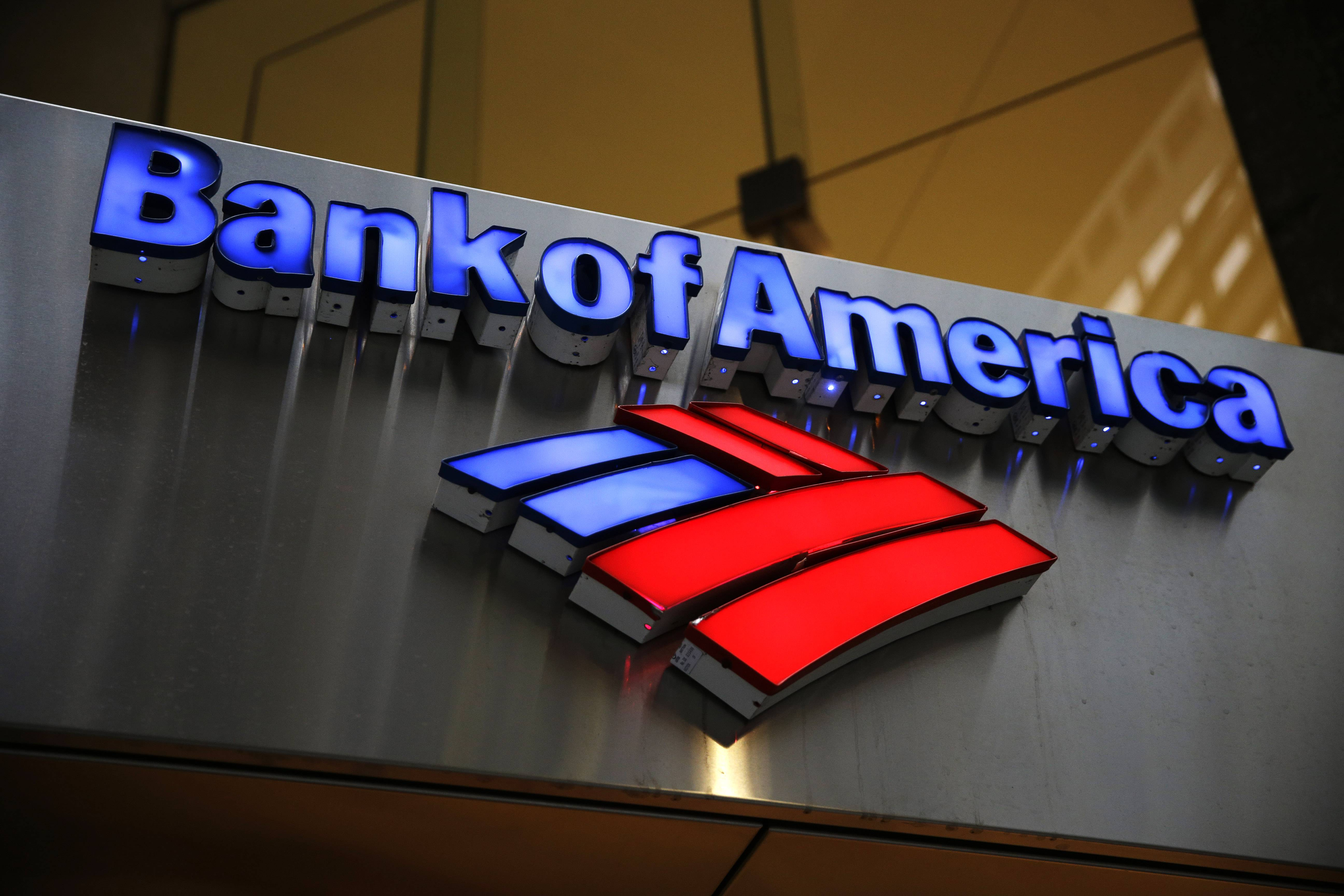 In this Jan. 14, 2014, file photo, a Bank of America sign is photographed in Philadelphia. A person familiar with the matter says Bank of America has agreed to pay between $16 billion and $17 billion to settle an investigation into its sale of mortgage-backed securities before the financial crisis.