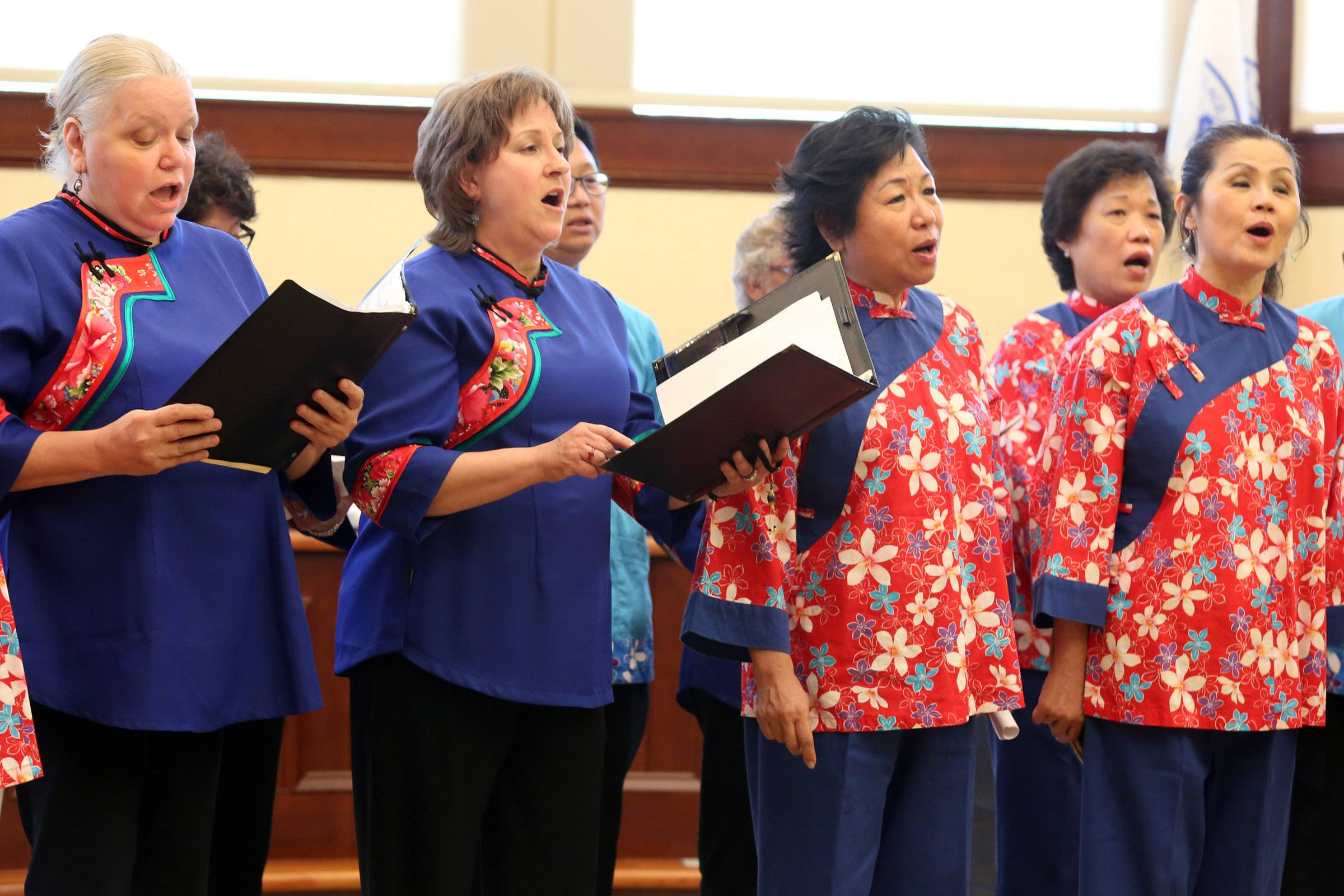 The Bartlett International Chorus joins the Chicago Hakka Chorus at Bartlett's village hall to officially open a photo exhibit featuring Taiwanese photographers.