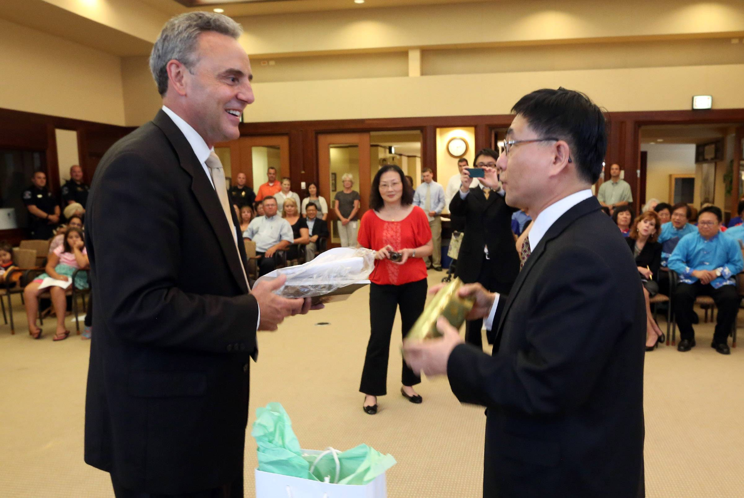 Bartlett Mayor Kevin Wallace and Baushuan Ger, right, director general of the Taipei Economic and Cultural Office in Chicago, exchange gifts during Wednesday's ceremony.