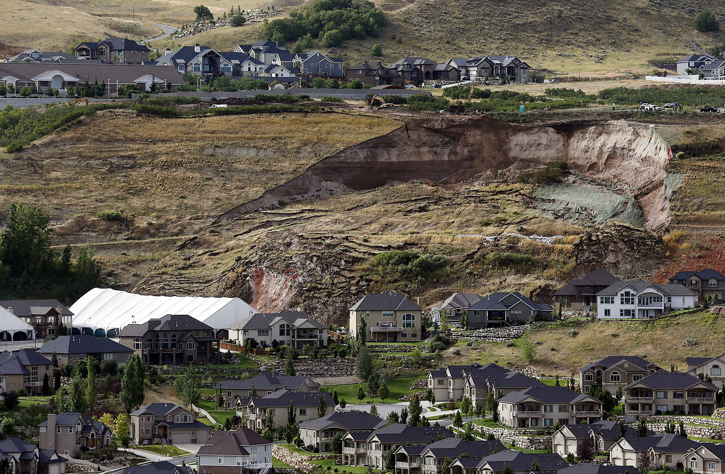 One home was destroyed and 27 others were evacuated after a landslide early Tuesday struck an upscale suburban Salt Lake City community, where officials had worried for nearly a year about cracked soil on the hillside above the houses.