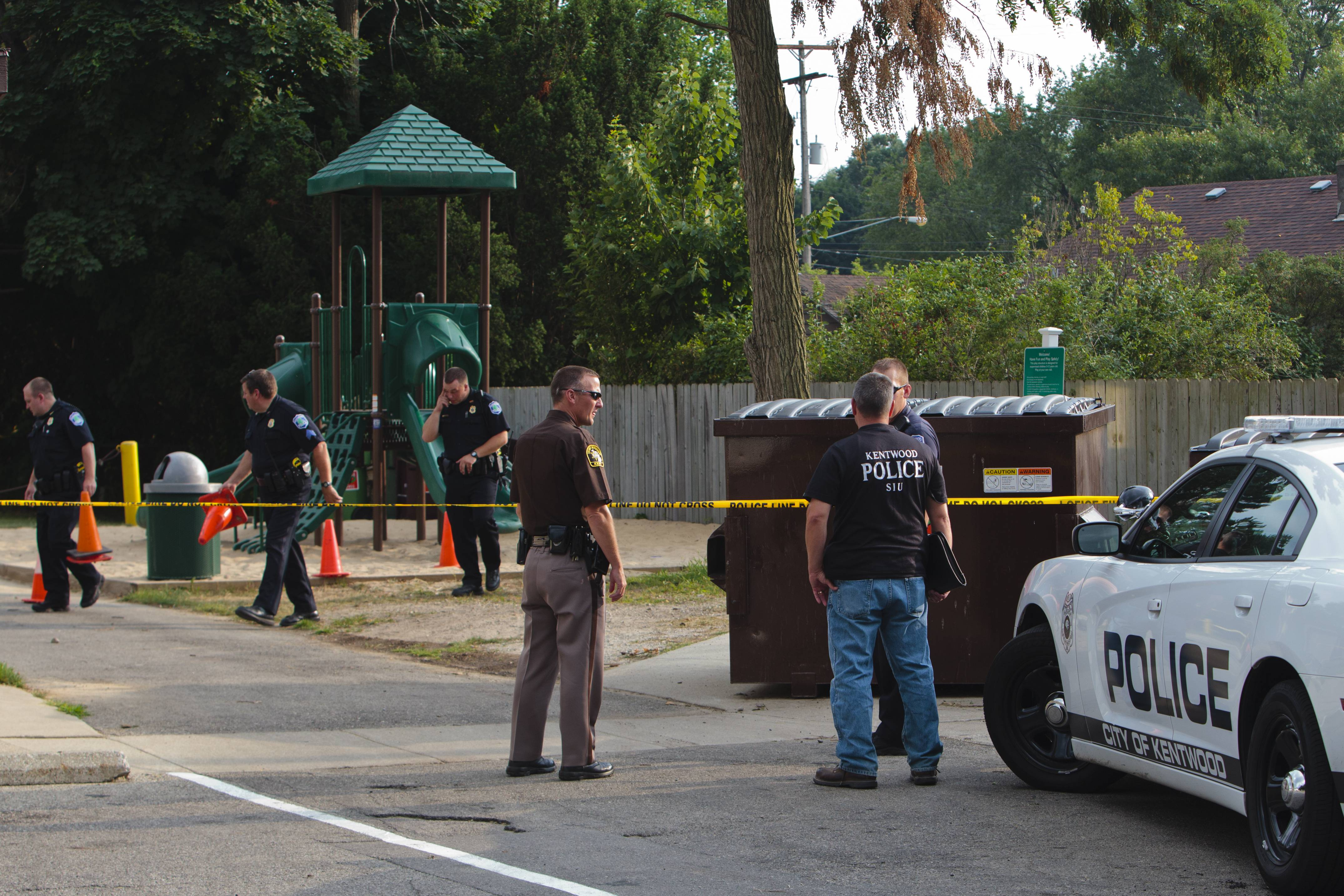 Kentwood police investigate a stabbing that occurred in a playground in Pinebrook Village, in Kentwood, Mich., on Aug. 4, 2014.