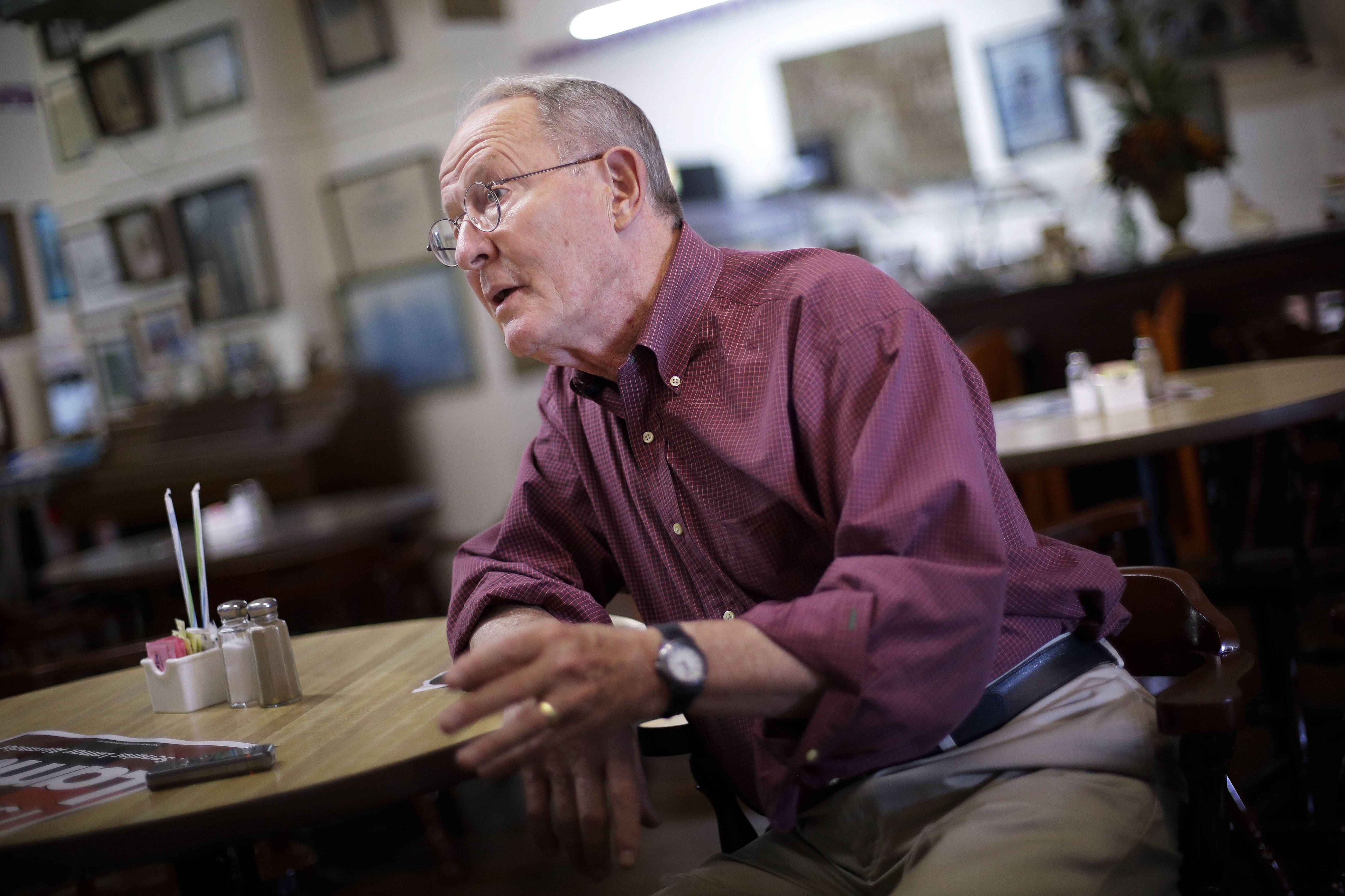 Sen. Lamar Alexander, R-Tenn., a 74-year-old incumbent, is seeking to fend off challenger Joe Carr in Tennessee's primary election Thursday. Carr has cast Alexander as out of touch with an increasingly conservative electorate.