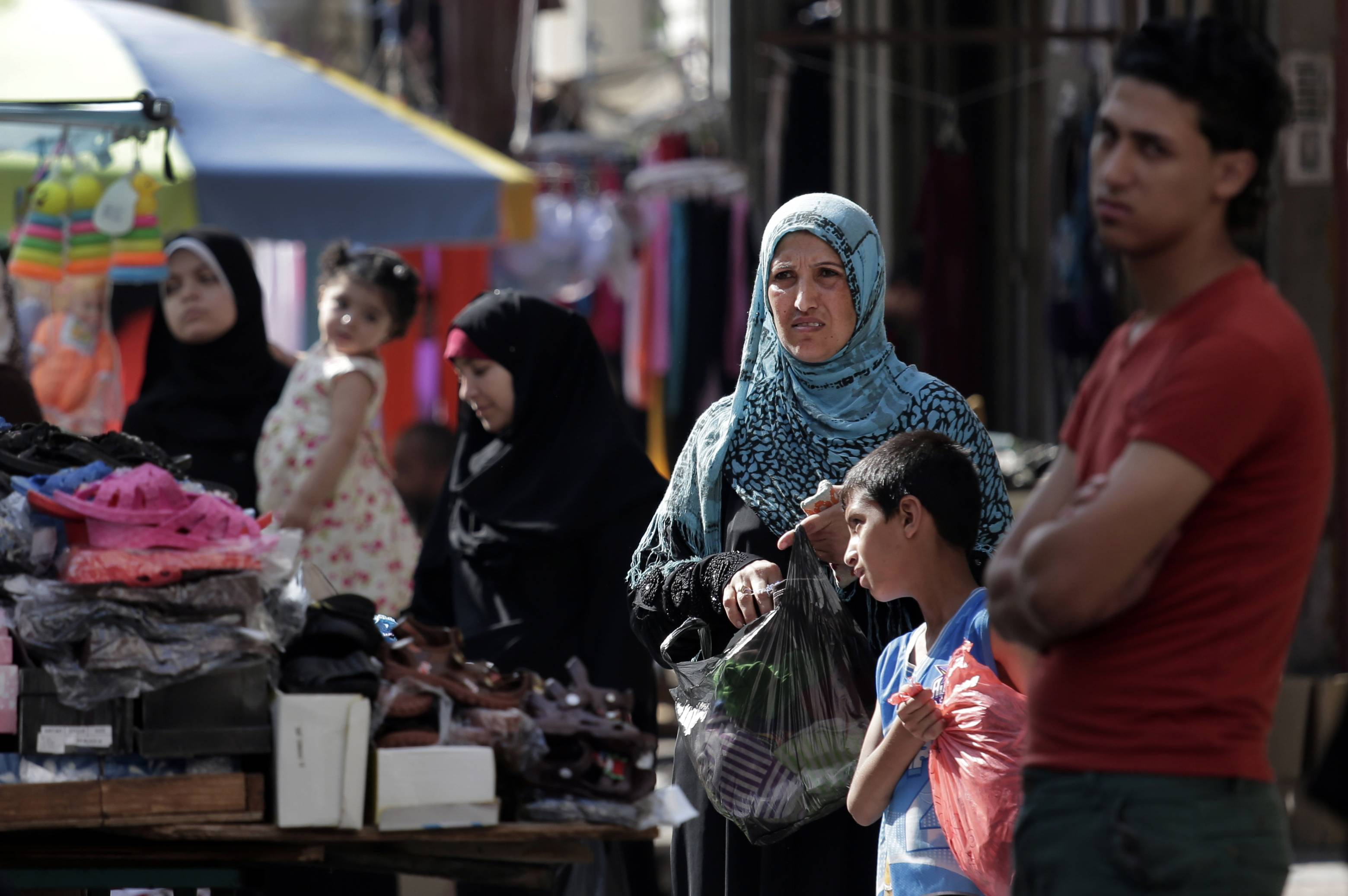 Palestinians shop Wednesday at a market in Gaza City. A cease-fire between Israel and Hamas that ended a month of fighting is holding for a second day, ahead of negotiations in Cairo on a long-term truce and a broader deal for the war-ravaged Gaza Strip.