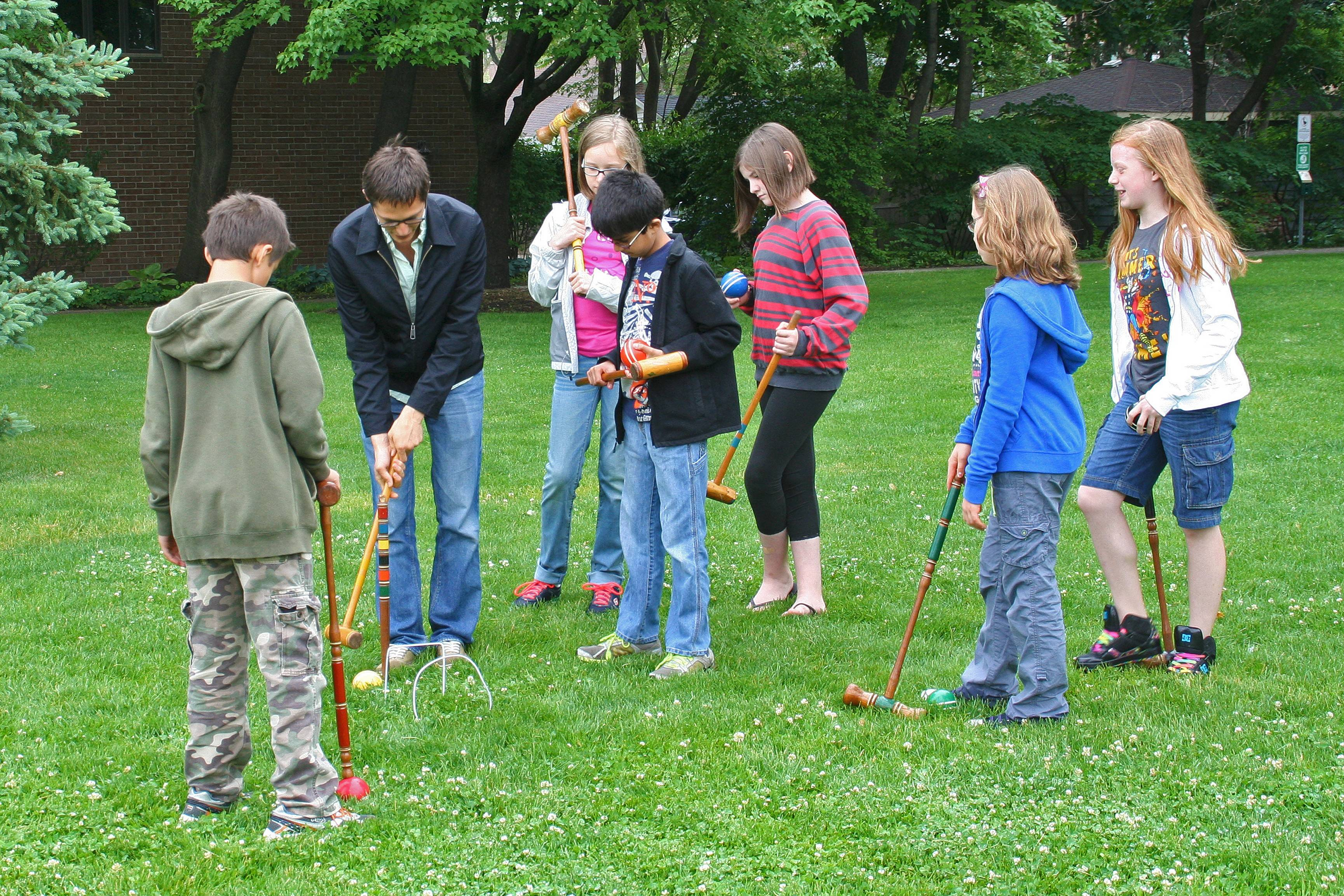 Philip Mohr, curator for the Des Plaines History Center teaches the CHIPs students how to play croquet in Central Park.