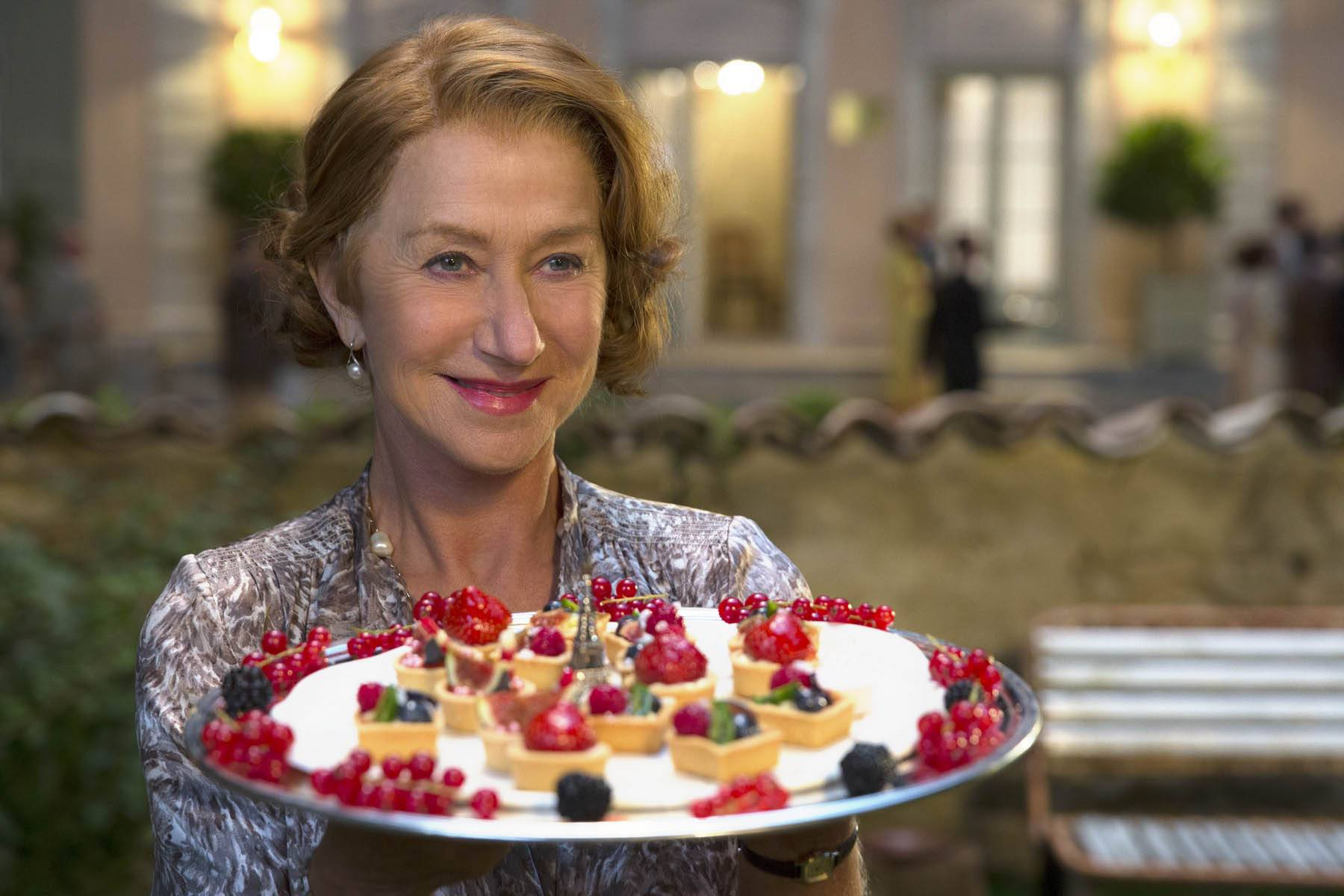 "Madame Mallory (Helen Mirren) shows off a tray of pastries in ""The Hundred-Foot Journey."""