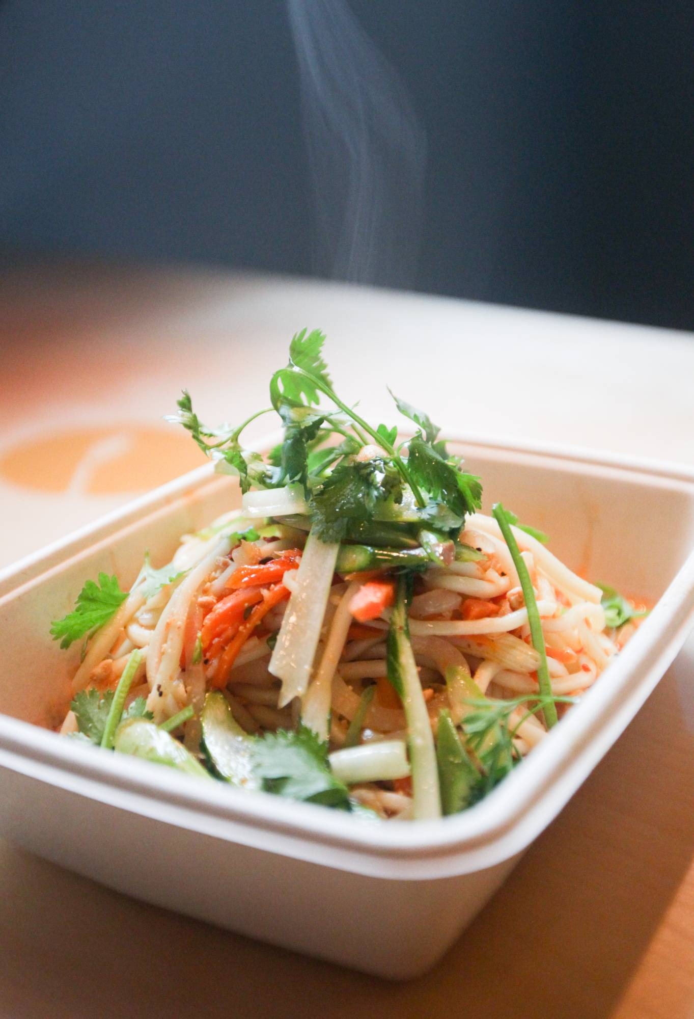 Noodle-udon comes with bok choy, carrots, crushed peanuts, ginger and fresh herb at Harvest in downtown Traverse City. It's the brainchild of Simon Joseph, an entrepreneurial chef who cruised into town three years ago aboard Roaming Harvest, the city's first food truck.