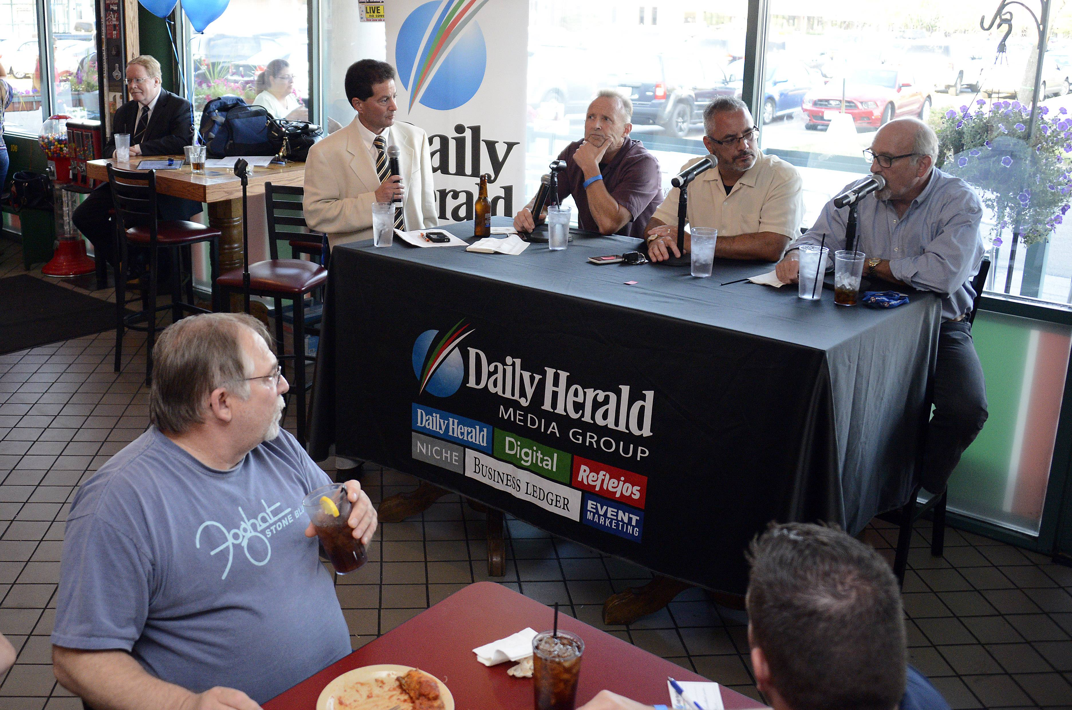 Hub Arkush of Chicago Football Magazine, far right, talks about the Bears' upcoming football season with, from left, sports columnist Barry Rozner, Bears beat writer Bob LeGere and sports writer Joe Aguilar, at a Daily Herald subscriber event Thursday at Coach's Corner in Elk Grove Village.