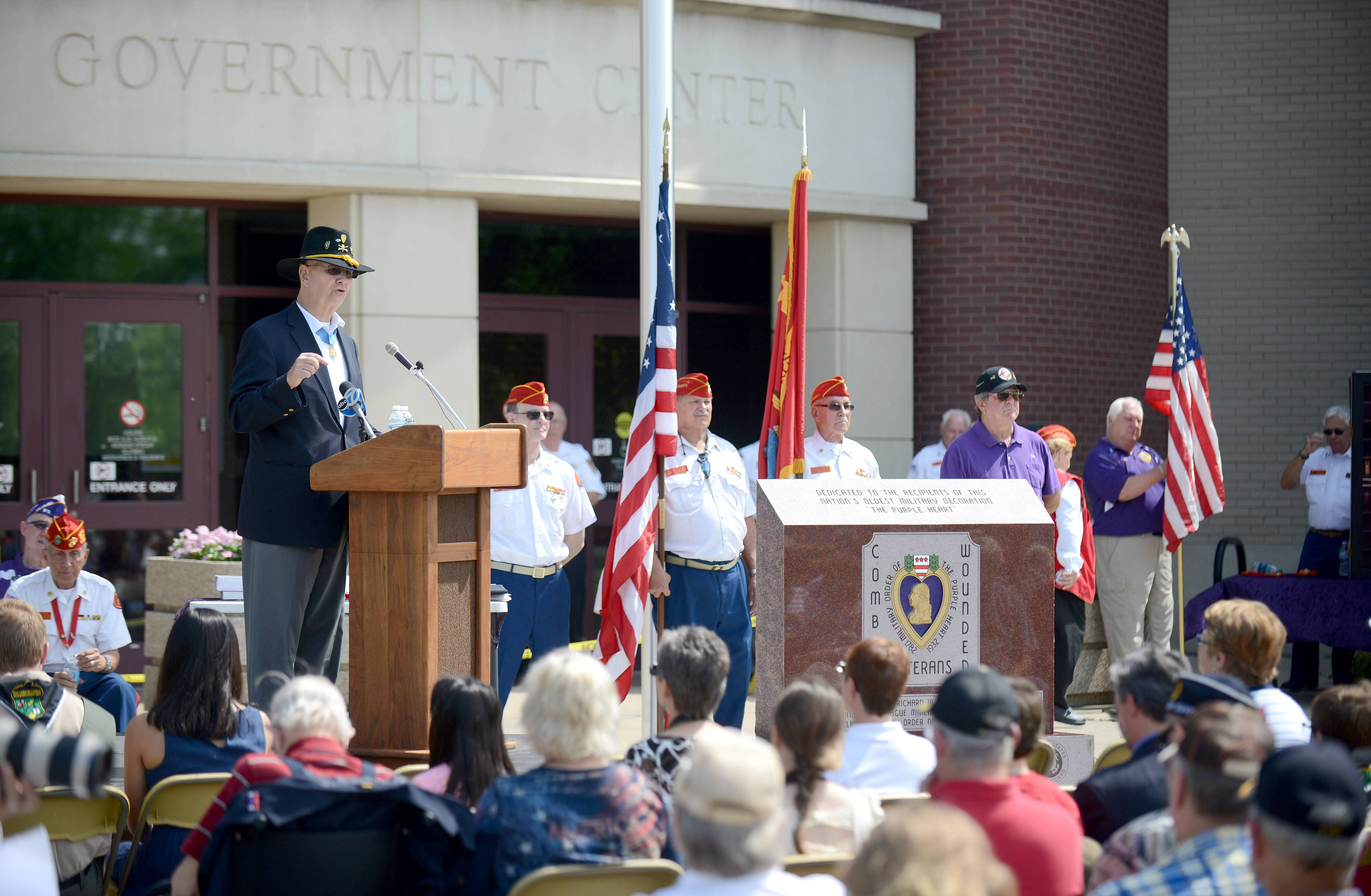 Guest speaker and Medal of Honor recipient Sgt. Alan J. Lynch of Gurnee addresses the crowd gathered Thursday for the dedication of the monument to all Purple Heart recipients in McHenry County.