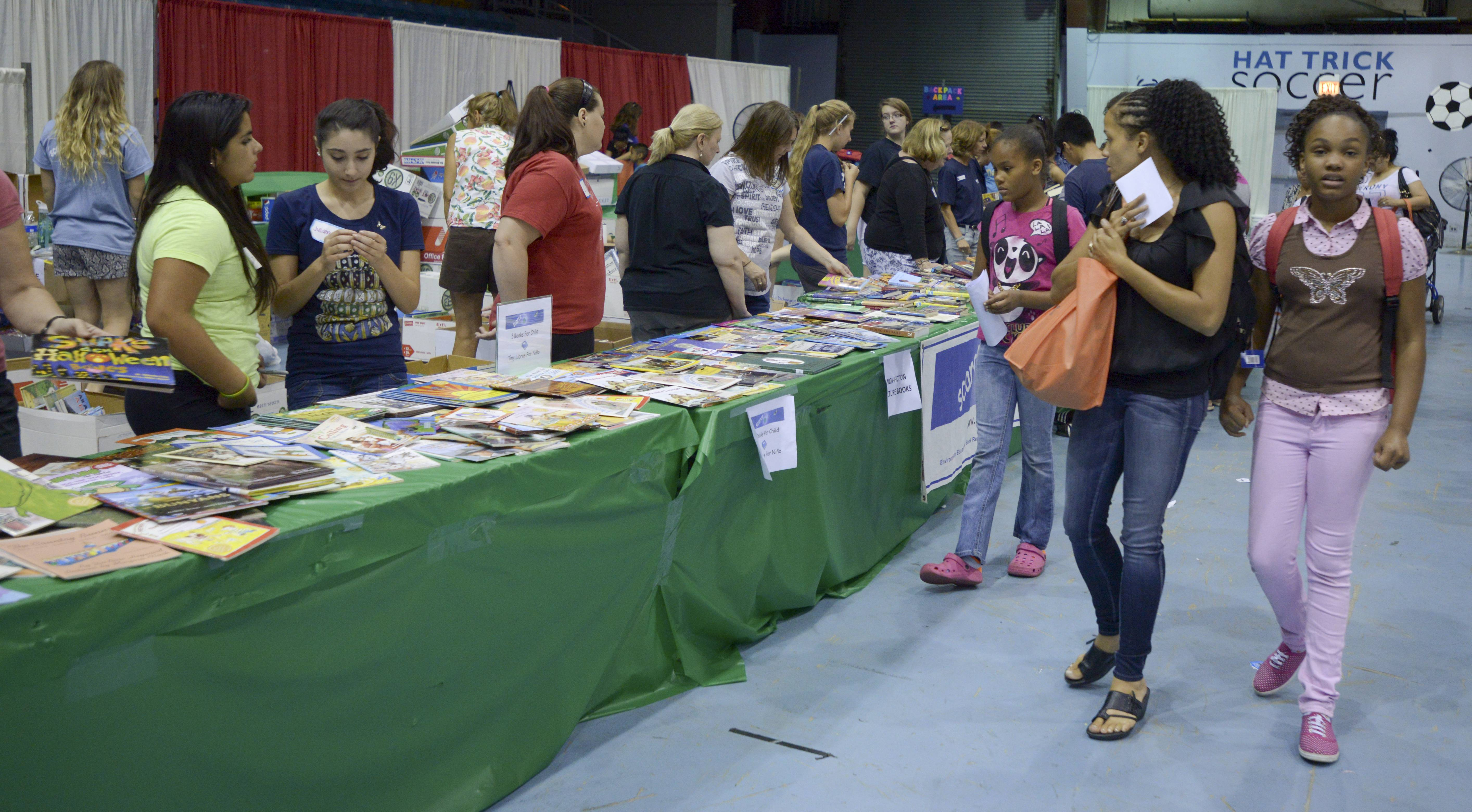 Tables full of books were available for children to choose from during Catholic Charities' Back to School Fair at the Odeum Expo Center in Villa Park.