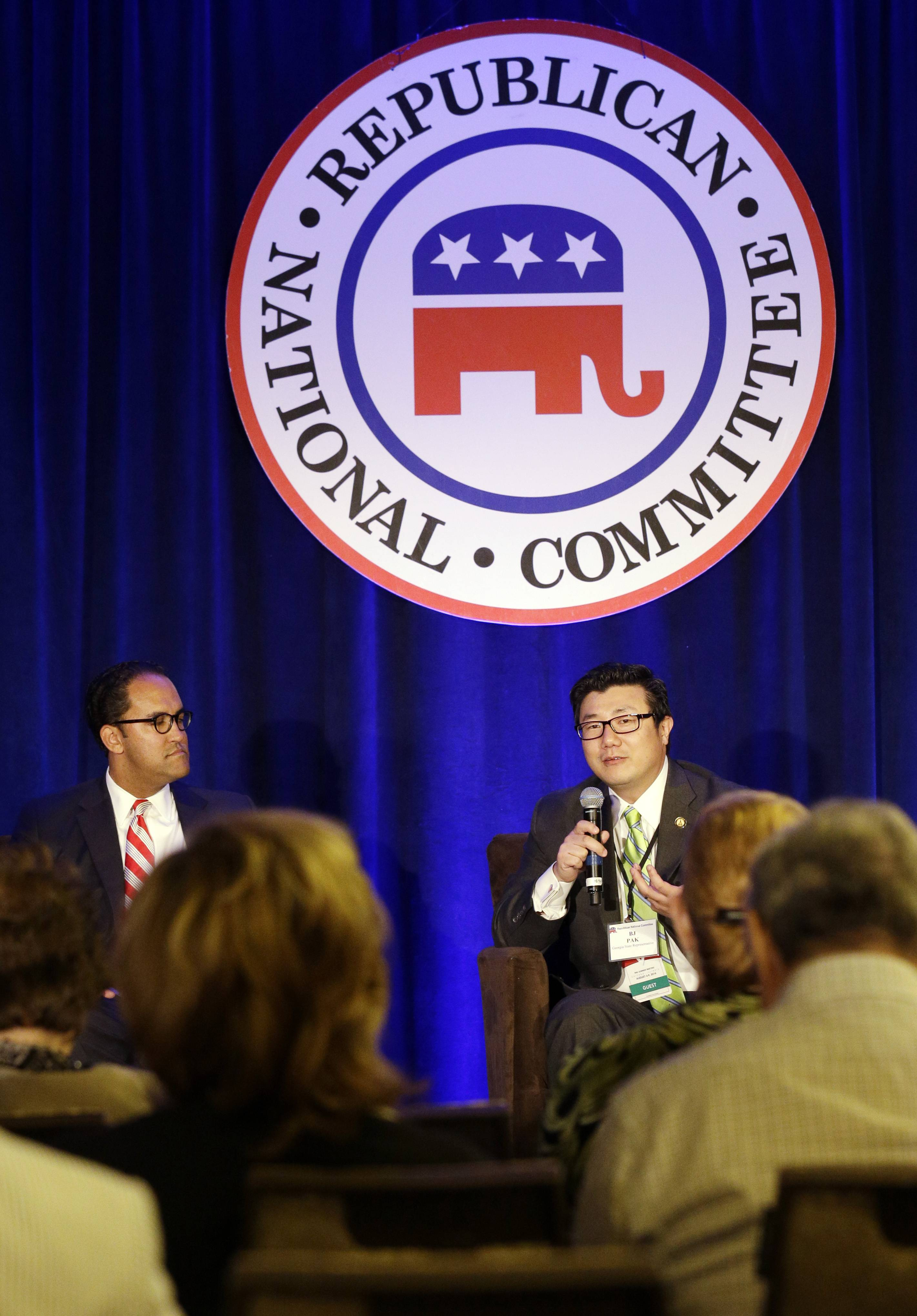 BJ Park, a state representative from Georgia, right, speaks as Will Hurd, a congressional candidate from Texas, listens to him Thursday during the Republican National Committee summer meeting in Chicago.