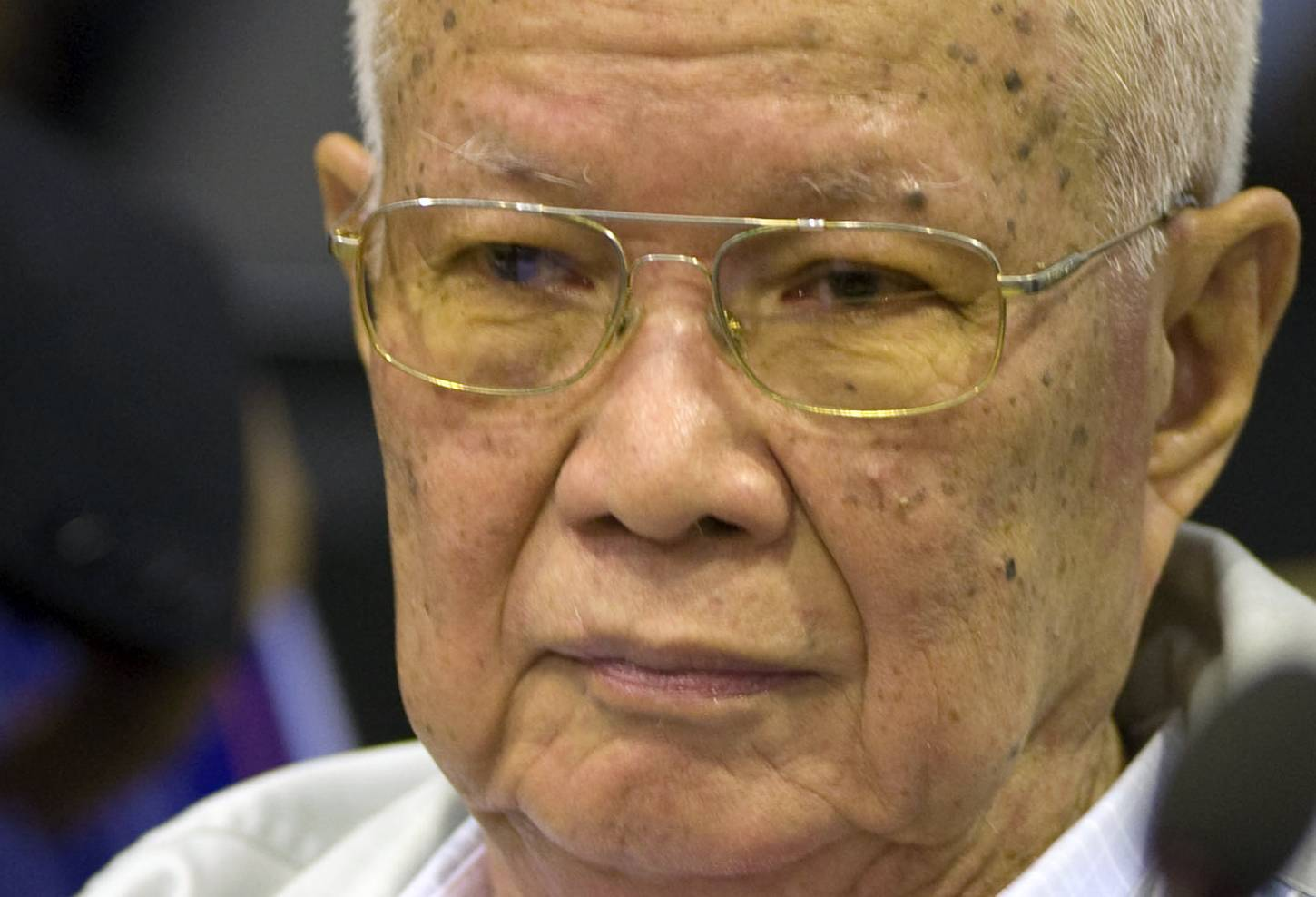 Khieu Samphan, the Khmer Rouge's former head of state, sits inside the courtroom of a U.N.-backed war crimes tribunal in Phnom Penh, Cambodia, Thursday, Aug. 7, 2014. Three and a half decades after the genocidal rule of Cambodia's Khmer Rouge ended, the U.N.-backed tribunal on Thursday sentenced Khieu Samphan and Nuon Chea, two top leaders of the former regime, to life in prison for crimes against humanity during the country's 1970s terror period that left close to 2 million people dead.