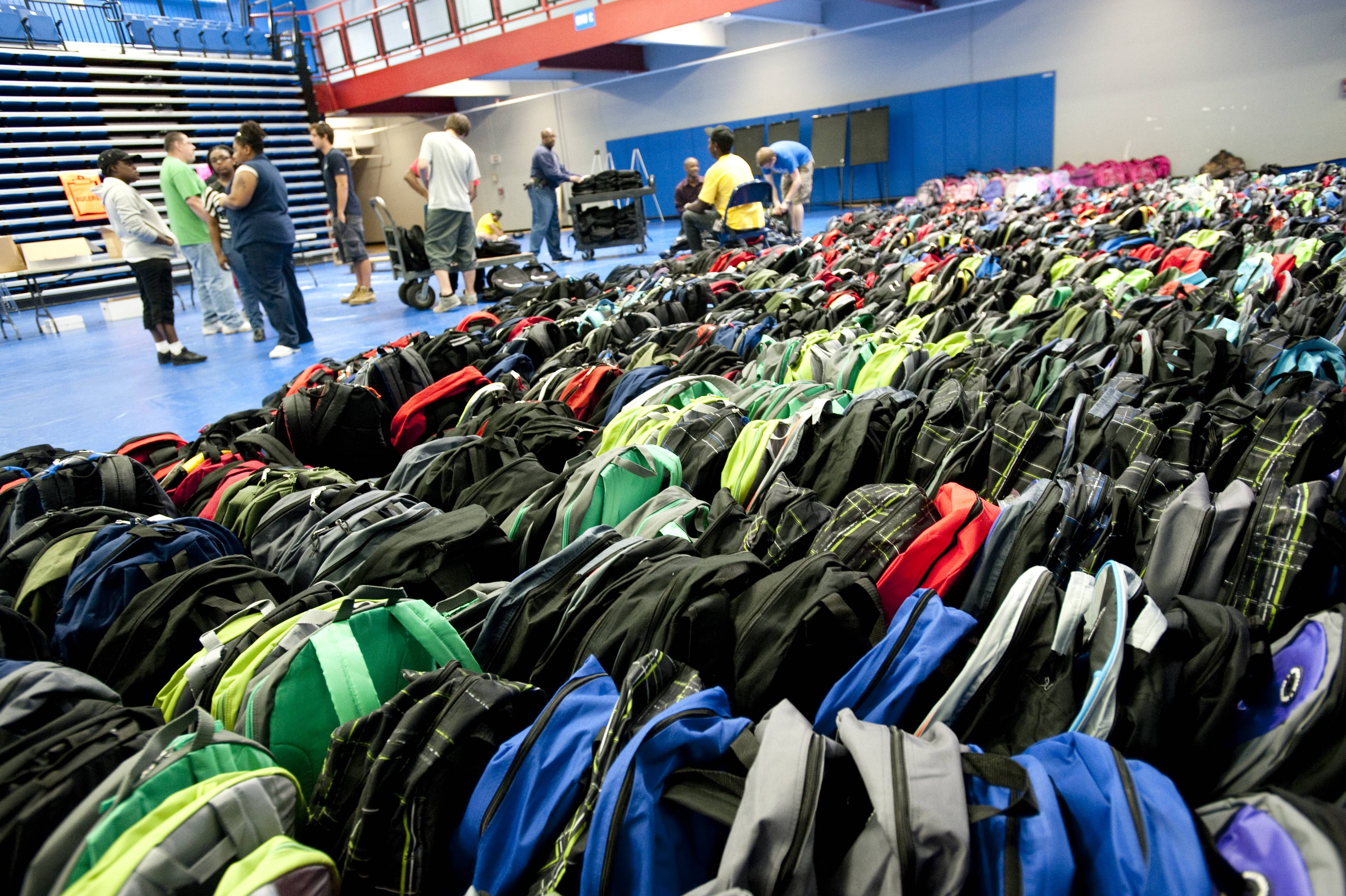 Elgin Community College and its partners will give away thousands of backpacks filled with school supplies and food to students in need Saturday during the fifth Project Backpack.