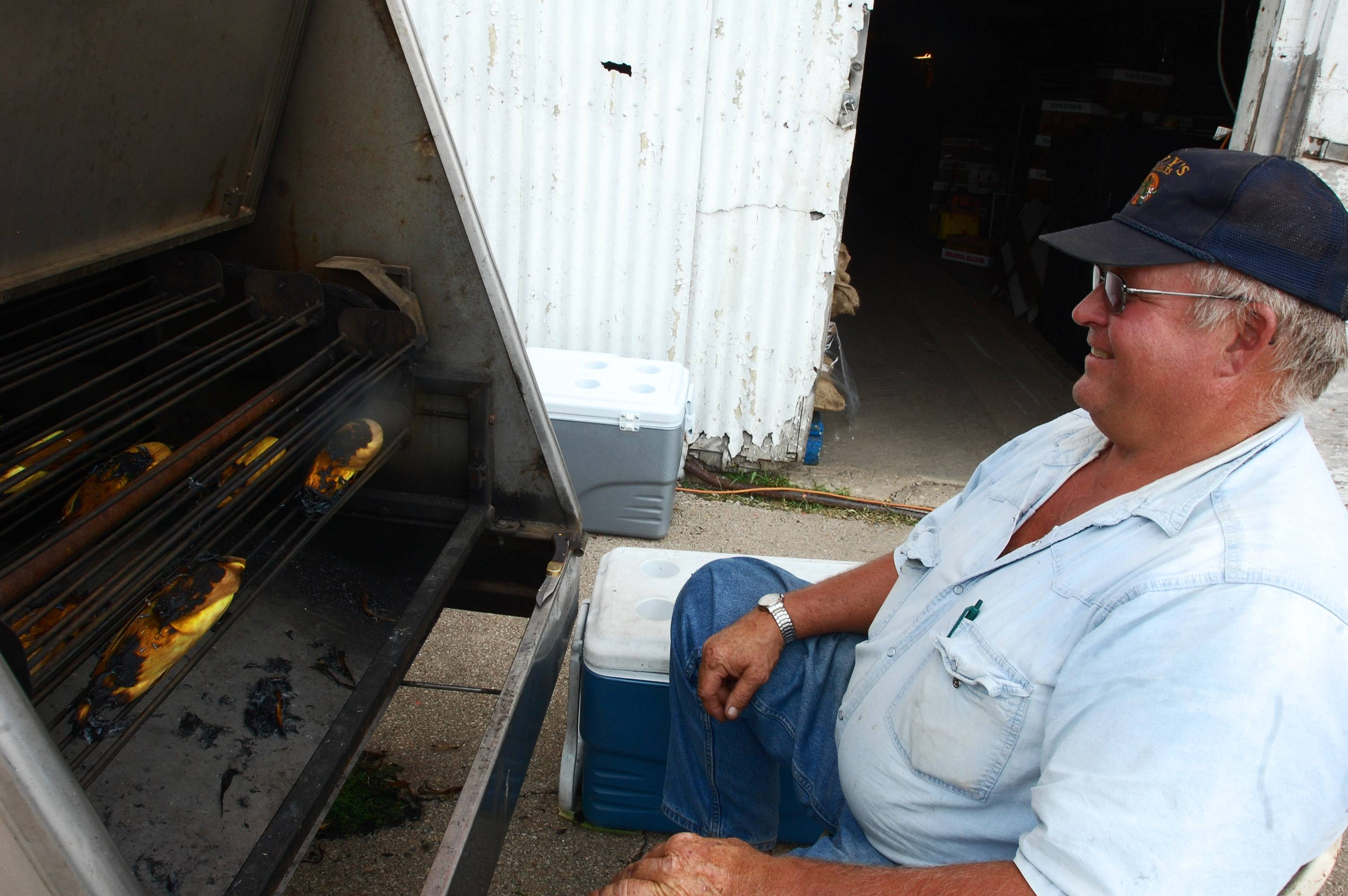Randy Gaitsch, owner of Randy's Vegetables, keeps an eye on the ears of corn roasting at the third annual Corn Roast fundraiser in Sleepy Hollow. The event, which takes place Sunday, Aug. 10, raises money for Special Olympics Illinois.