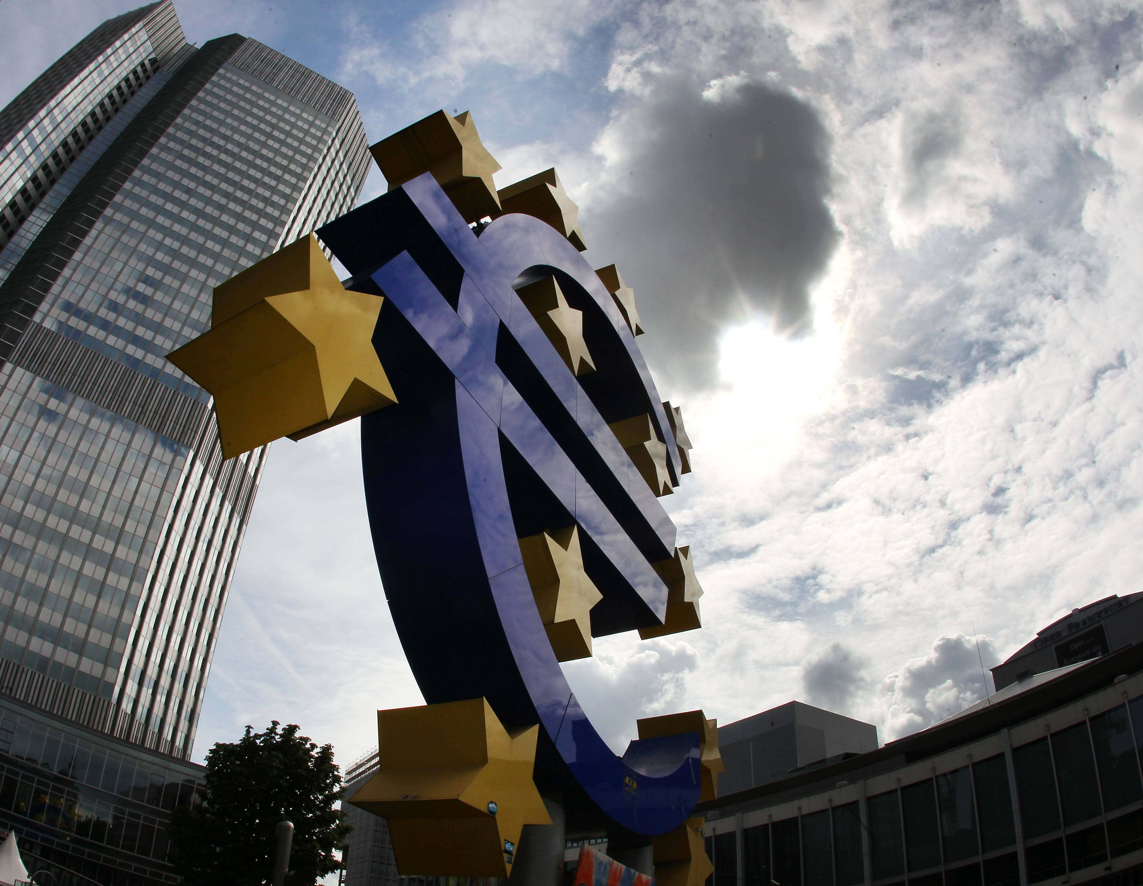 The euro sculpture in front of the headquarters of the European Central Bank, ECB, in Frankfurt, Germany. The crisis in Ukraine and a hesitant recovery in Europe are casting shadows over the European Central Bank's meeting Thursday.