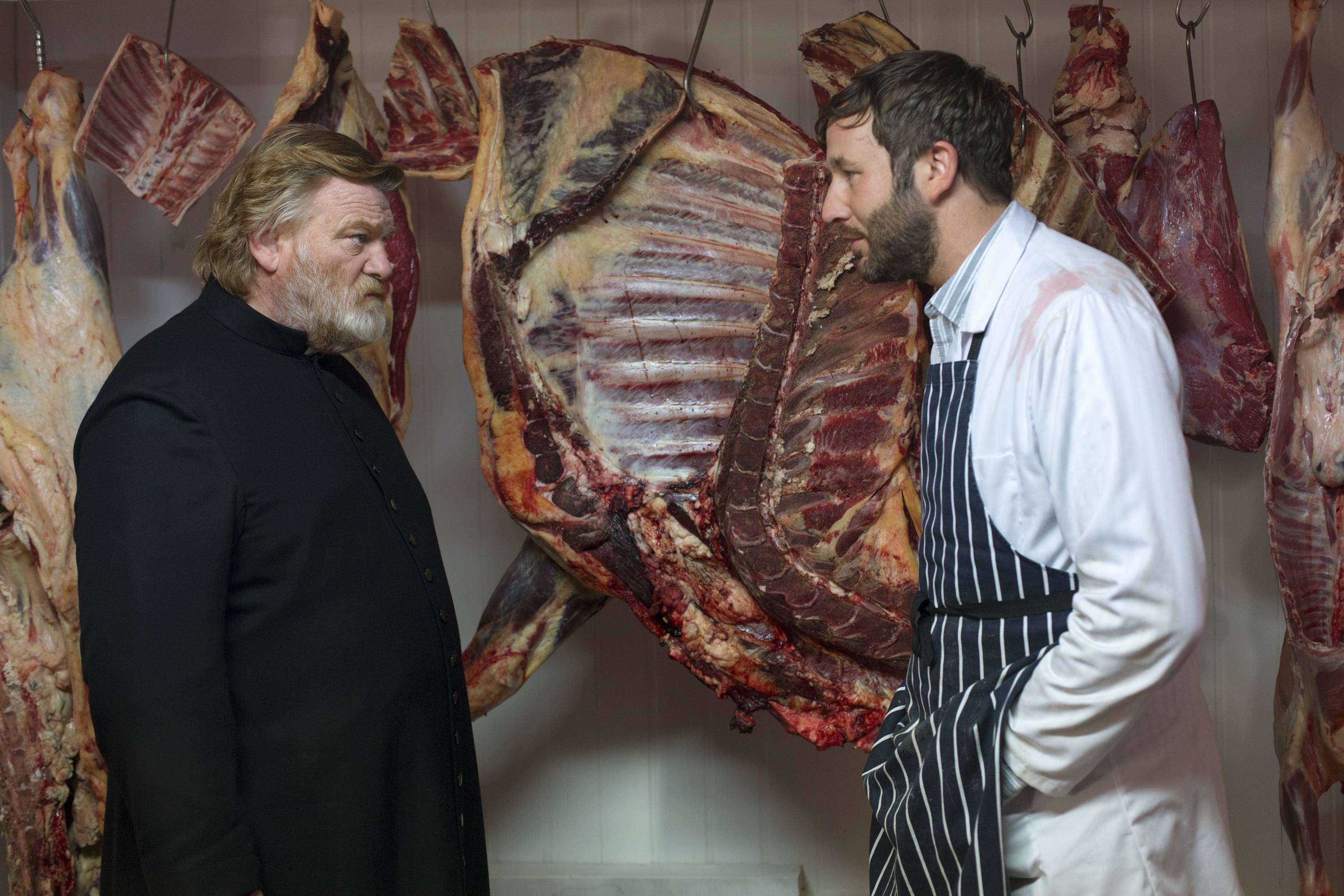 "Father James (Brendan Gleeson, left) meets with a parishioner (Chris O'Dowd) in ""Calvary."""