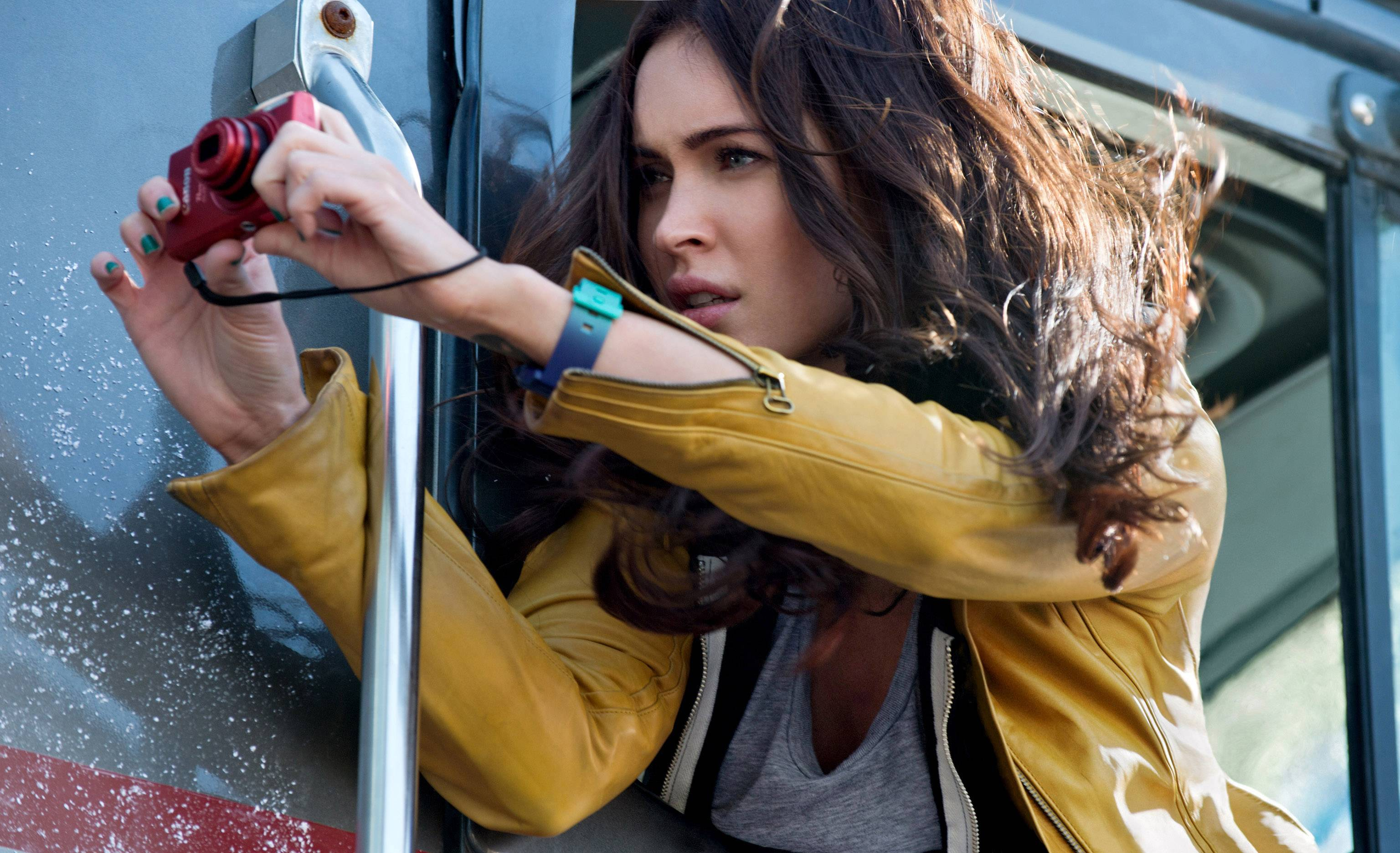 "Reporter April O'Neil (Megan Fox) goes after a big story in ""Teenage Mutant Ninja Turtles."""