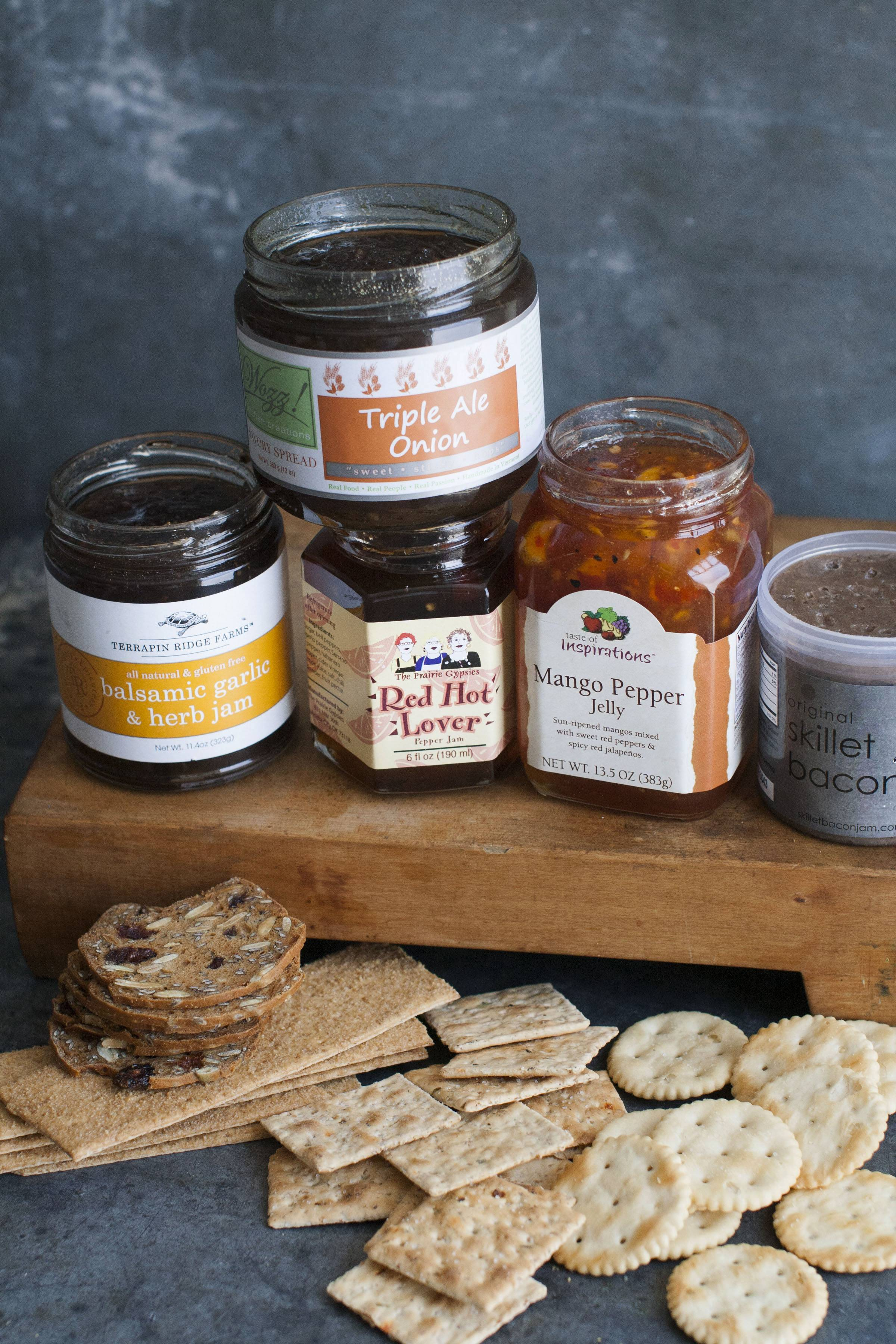 Savory jams, like Terrapin Ridge Farms balsamic garlic and herb jam, from left, Wozz Kitchen Creations triple ale onion jam, The Prairie Gypsies red hot lover jam, Taste of Inspirations mango pepper jelly, and Skillet Bacon Spread original bacon spread go well with cheese plates.