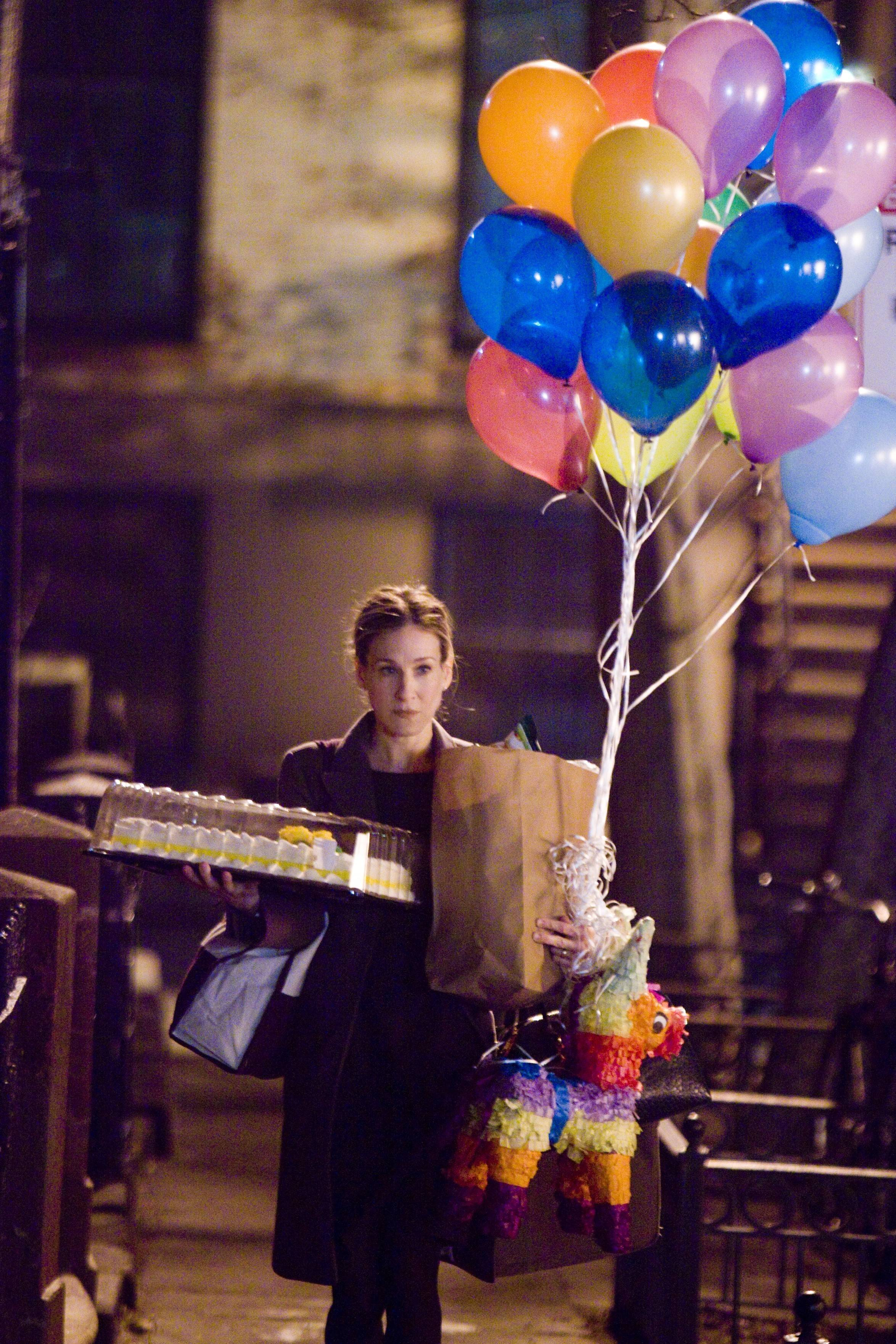 "Sarah Jessica Parker supplies the balloons cliche in the comedy ""Don't Know How She Does It."""