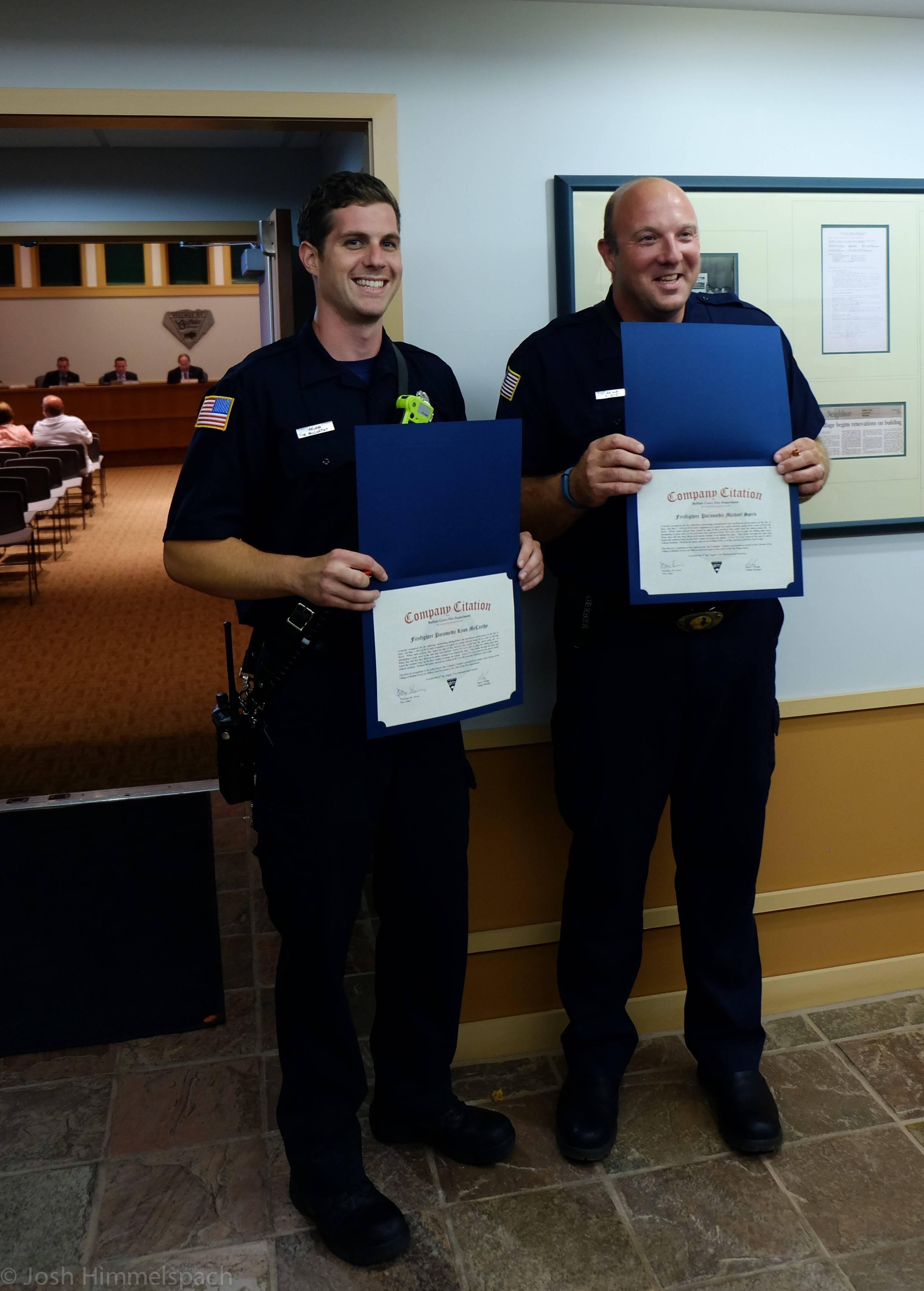 Buffalo Grove firefighter-paramedics Ryan McCarthy, left, and Mike Spiro are honored Aug. 4 by the village board.