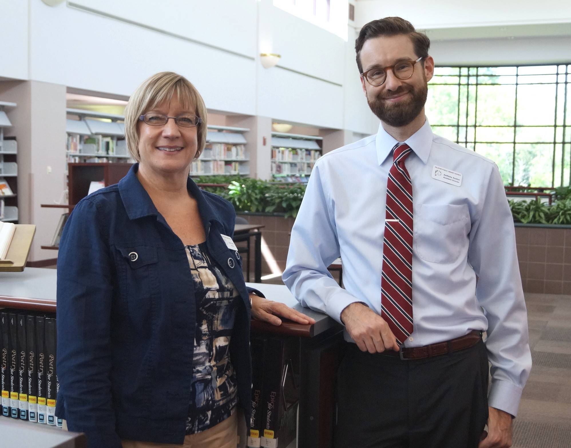 Anthony Auston, right, has been named the new director of the Palatine Public Library, taking over for Susan Strunk.
