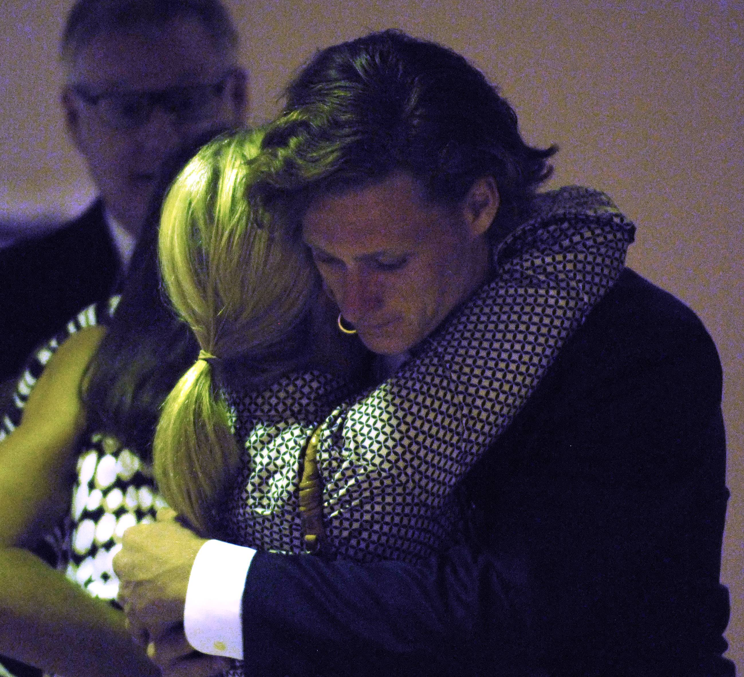 Karsten James Eilertsen, who pleaded guilty last month to his involvement in a fatal 2013 Barrington Hills auto collision, is hugged by family members prior to sentencing at the Rolling Meadows courthouse Thursday.