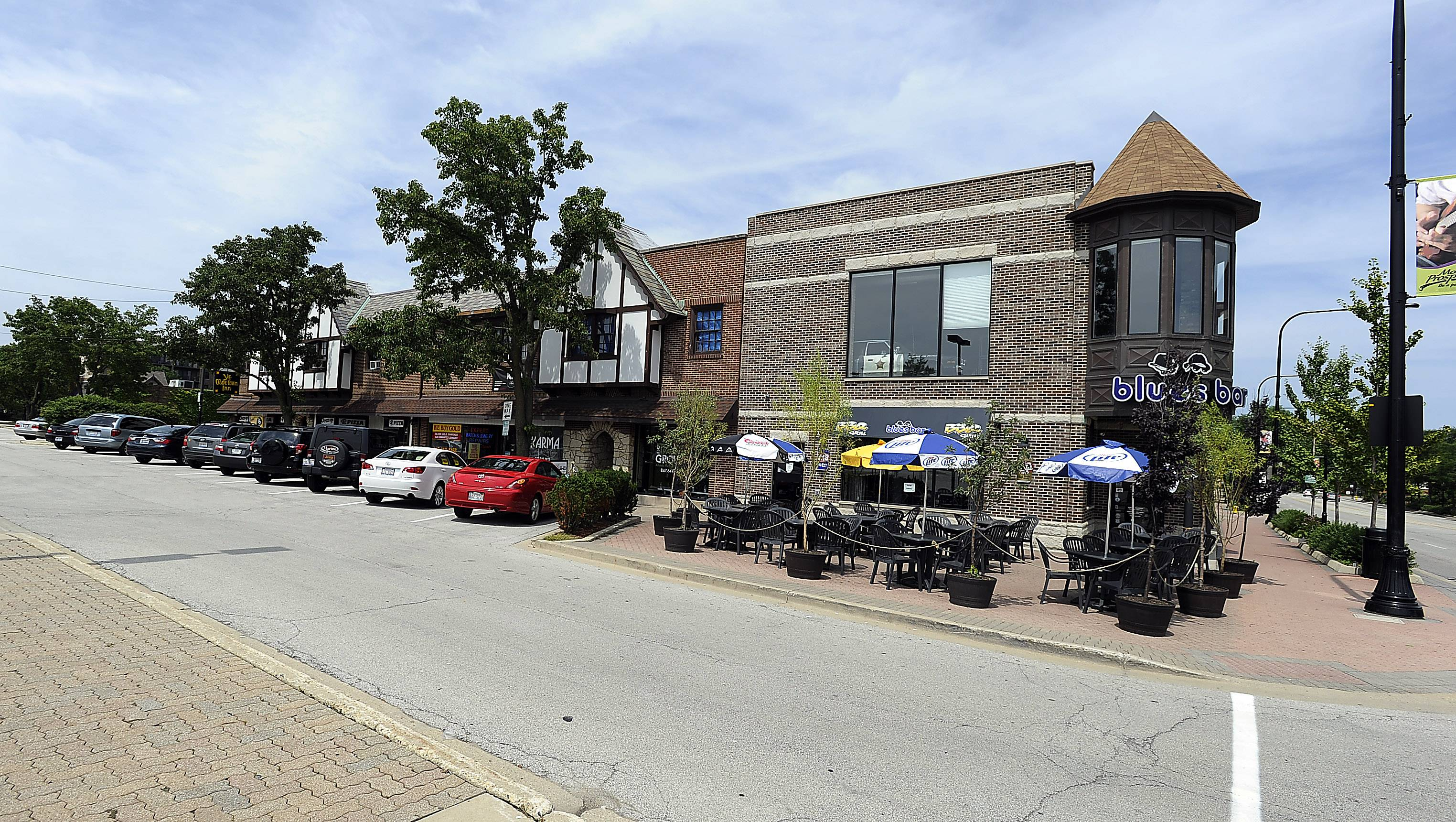 A row of businesses on Busse Avenue in Mount Prospect includes the Blues Bar and Ye Olde Town Inn.
