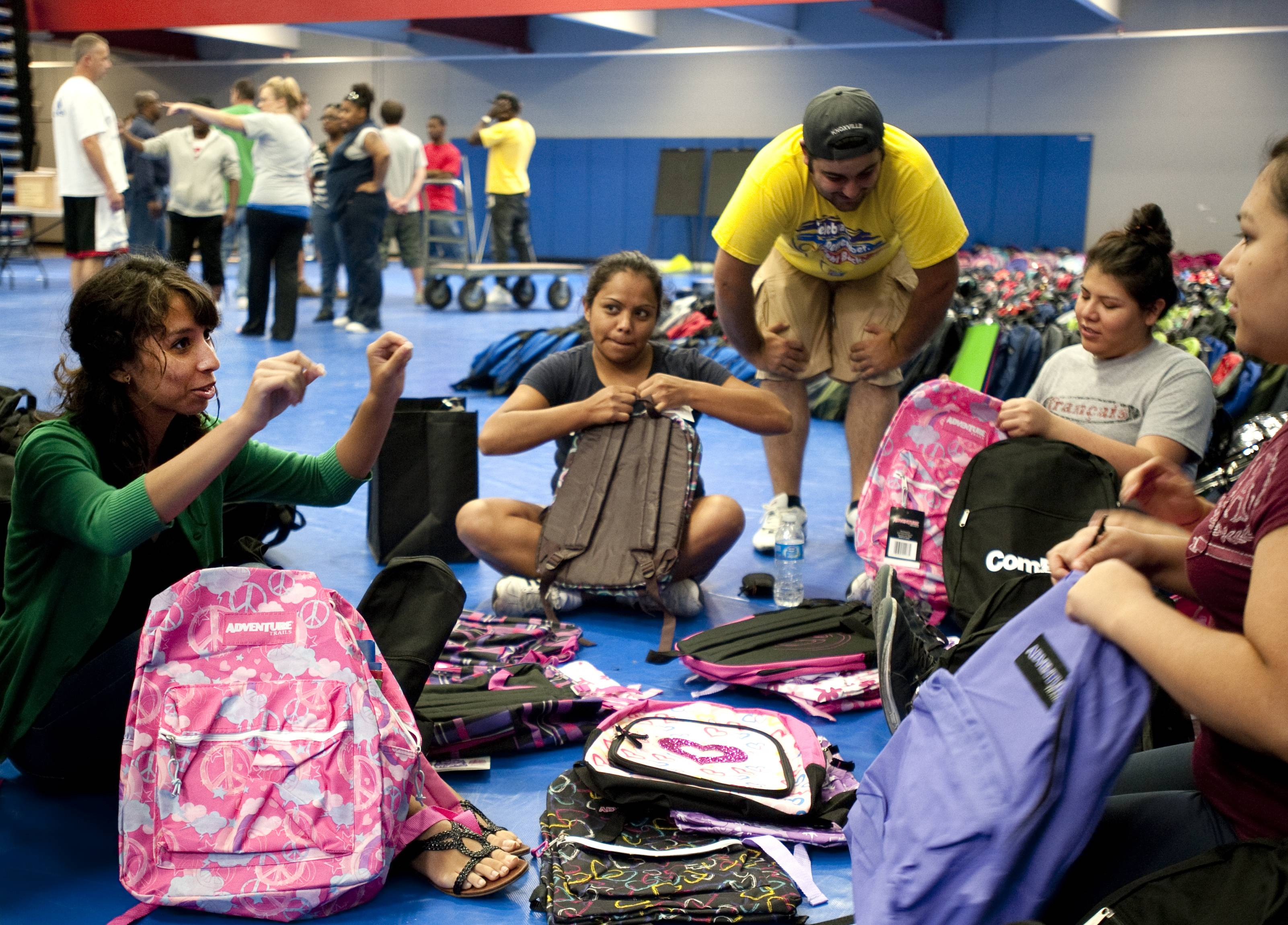 Elgin Community College students pack backpacks for a recent Project Backpack event. Roughly 5,000 people lined up for the event last year when the college gave away more than 2,000 backpacks. This year's backpack give away is 9 a.m. to 2 p.m. Saturday.