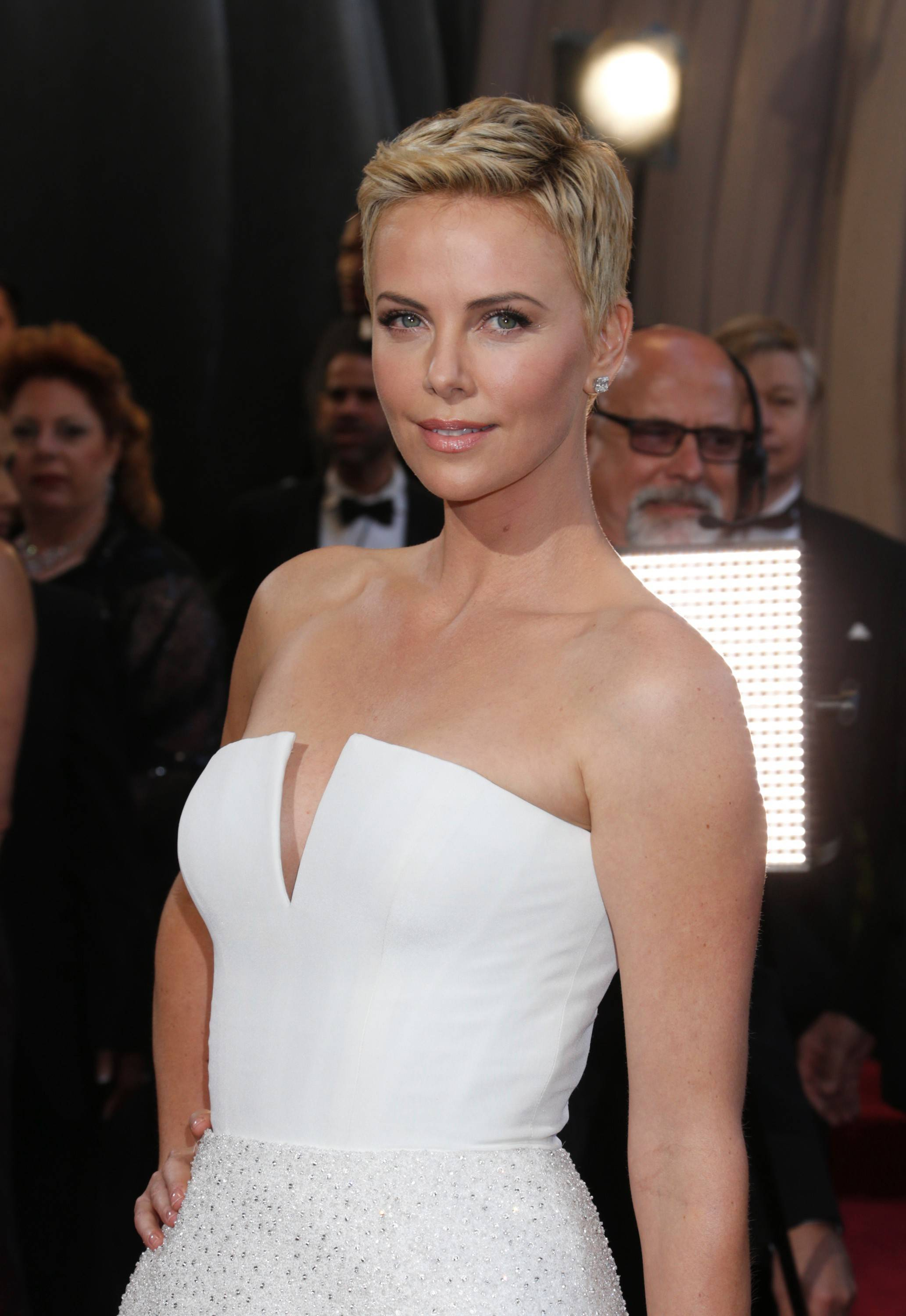 An Arkansas judge who disclosed confidential details about an adoption involving actress Charlize Theron has agreed to a lifetime ban from the state bench.
