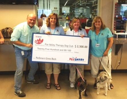 PetSmart General Manager John Kerns, left, presents a $2,500 donation from PetSmart to the Fox Valley Therapy Dog Club with club members Lora Johnson, Lisa Bowles and Diane Obey.