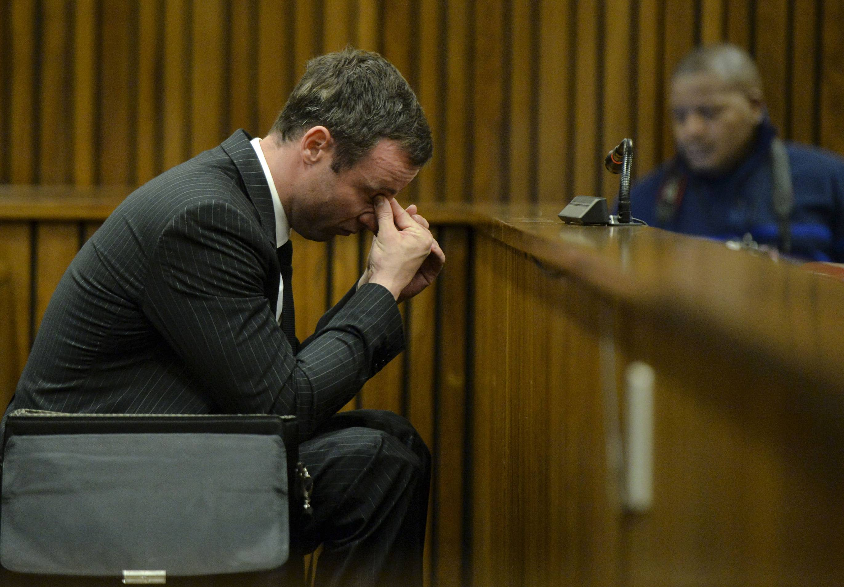 Oscar Pistorius, gestures, as he sits in court, during his trial in Pretoria, South Africa, Friday, Aug. 8, 2014. The judge in the murder trial said Friday that she will give a verdict on Sept. 11, ending a televised trial that stretched for five months and transfixed South Africans and others around the world.